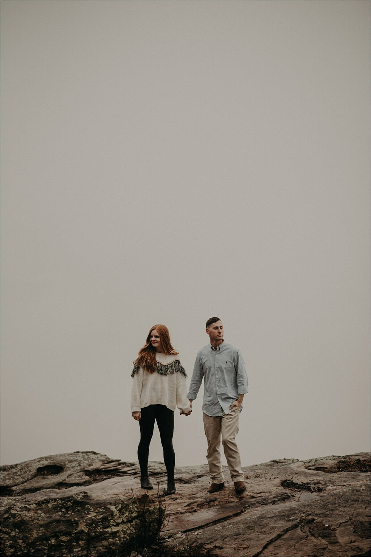 A foggy, white-out cloud engagement session on a mountain in Chattanooga, Tennessee
