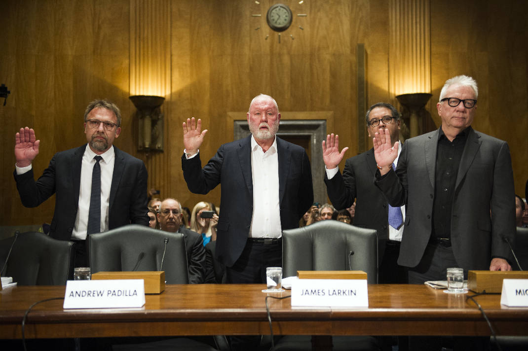 In this Jan. 10, 2017 file photo from left, Backpage.com CEO Carl Ferrer, former owner James Larkin, COO Andrew Padilla, and former owner Michael Lacey, are sworn-in on Capitol Hill in Washington, prior to testifying before the Senate Homeland Security and Governmental Affairs subcommittee hearing into Backpage.com's alleged facilitation of online sex trafficking. Ferrer, Lacy and Larkin appeared in Sacramento Superior Court Tuesday, Jan. 24 to face renewed charges that include pimping, conspiracy and money laundering. (AP Photo/Cliff Owen, File).  Photo by Cliff Owen
