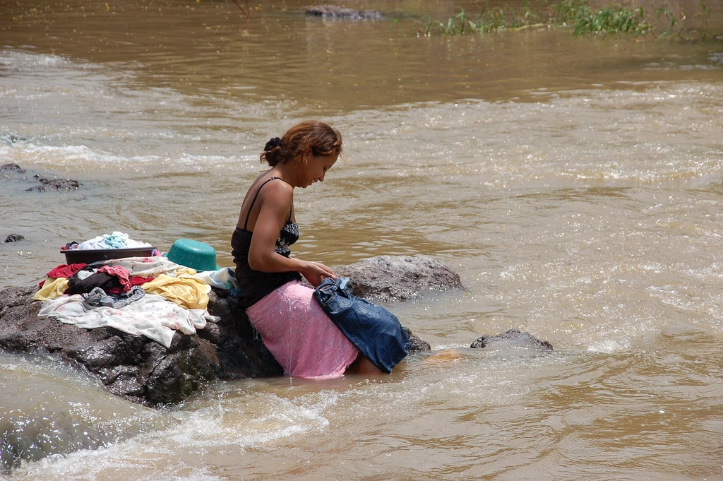 woman-using-river-water-min.jpg
