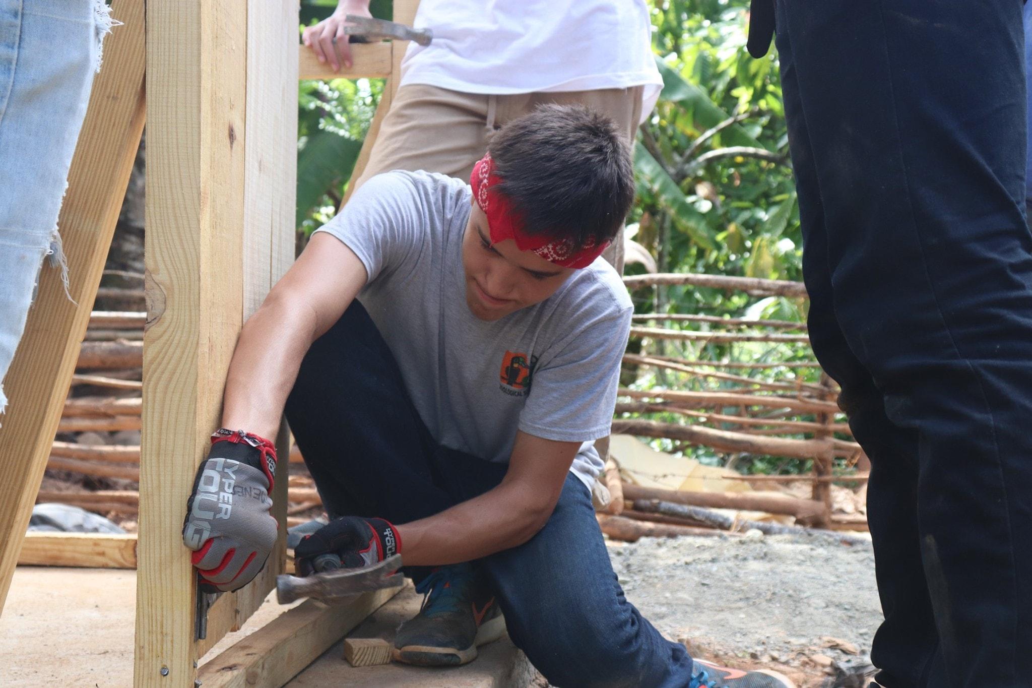 Hammering nails on a ventilated improves pit latrine.jpg