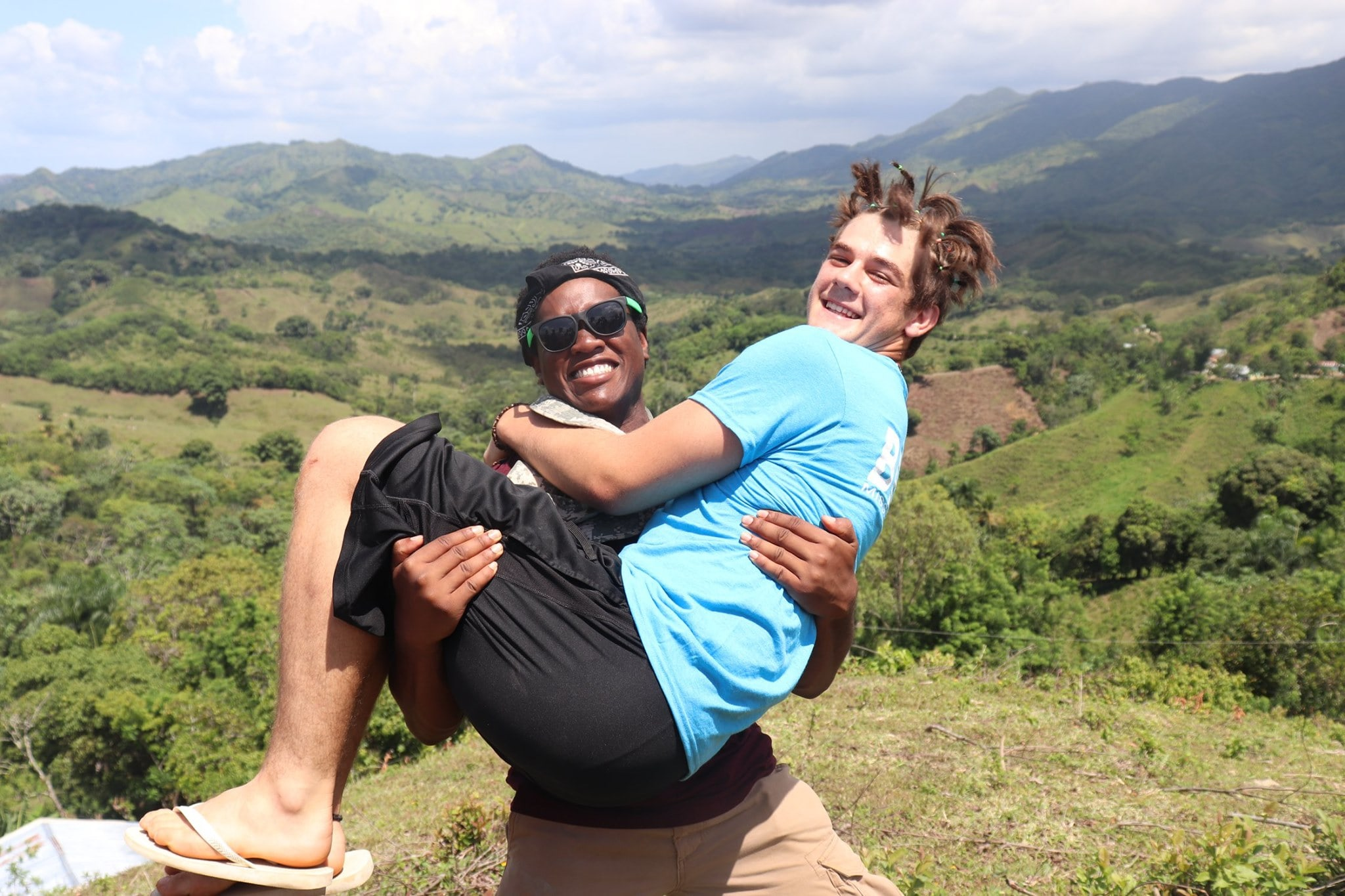 Teenager holding his friend and posing for a picture.jpg