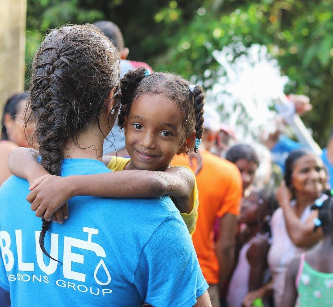 blue-missions-volunteers-with-a-local-community.jpg