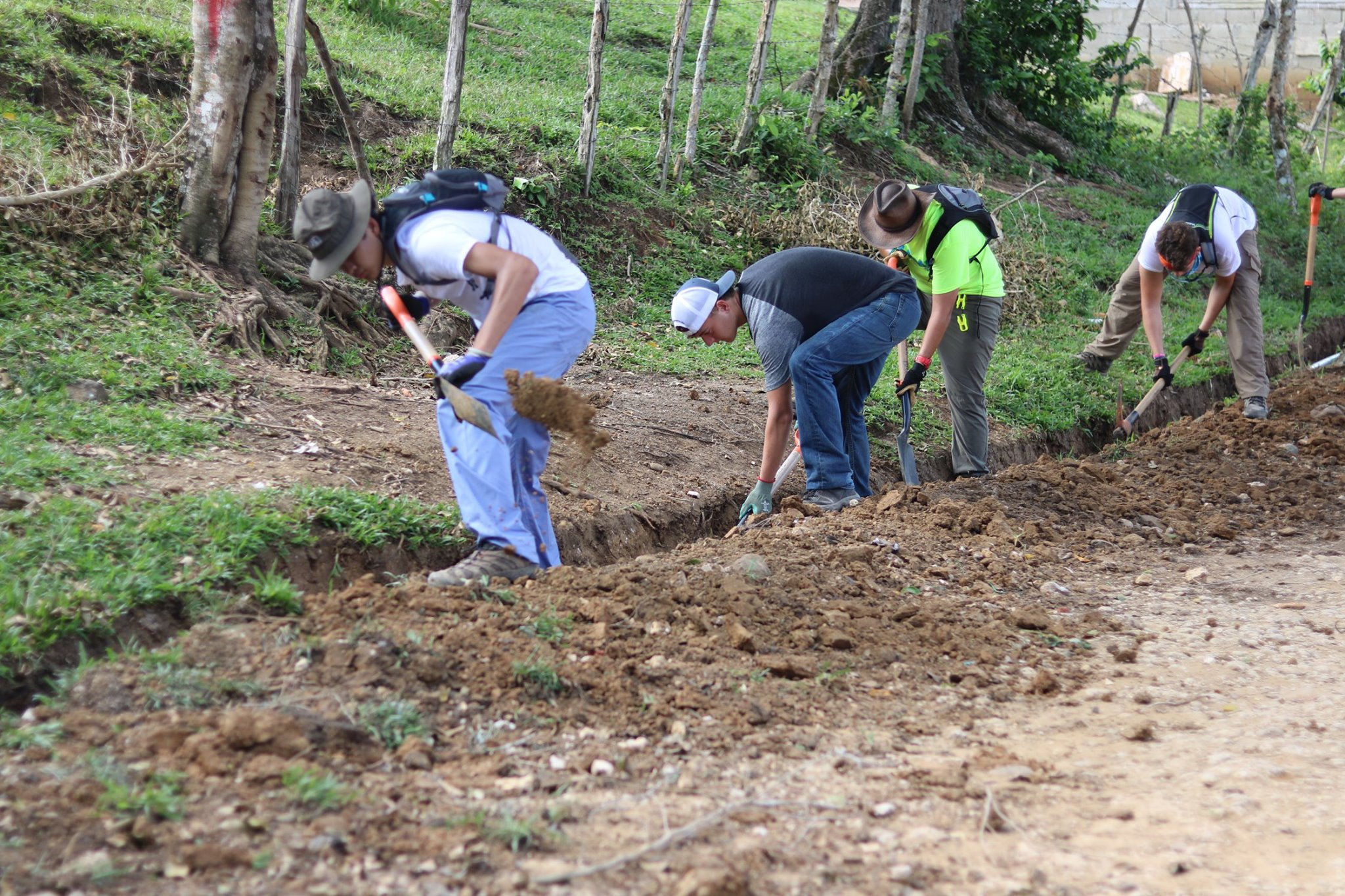 blue-missions-volunteers-digging-trenches-for-water-min.jpg
