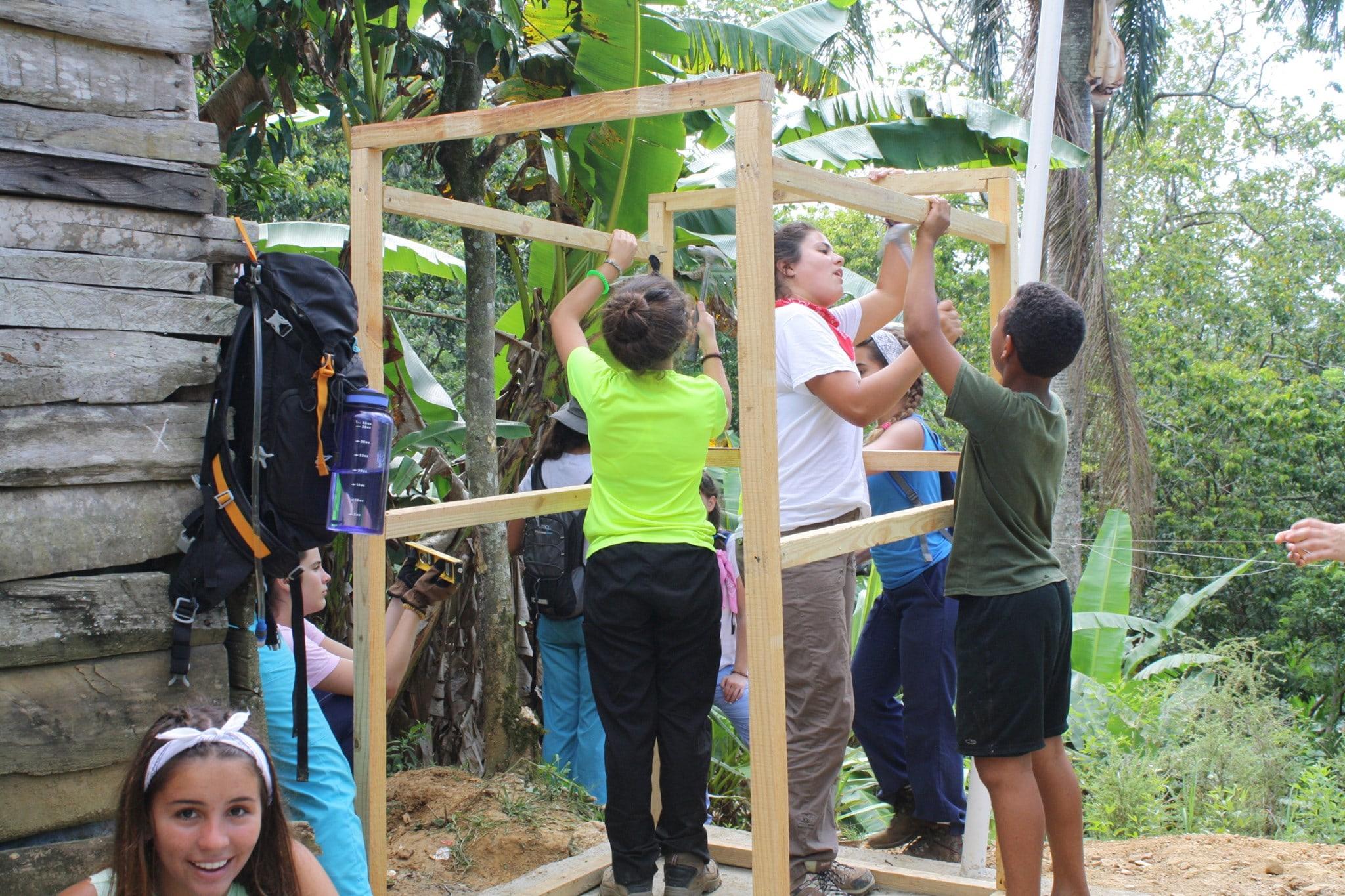 blue-missions-volunteers-building-a-latrine-min.jpg