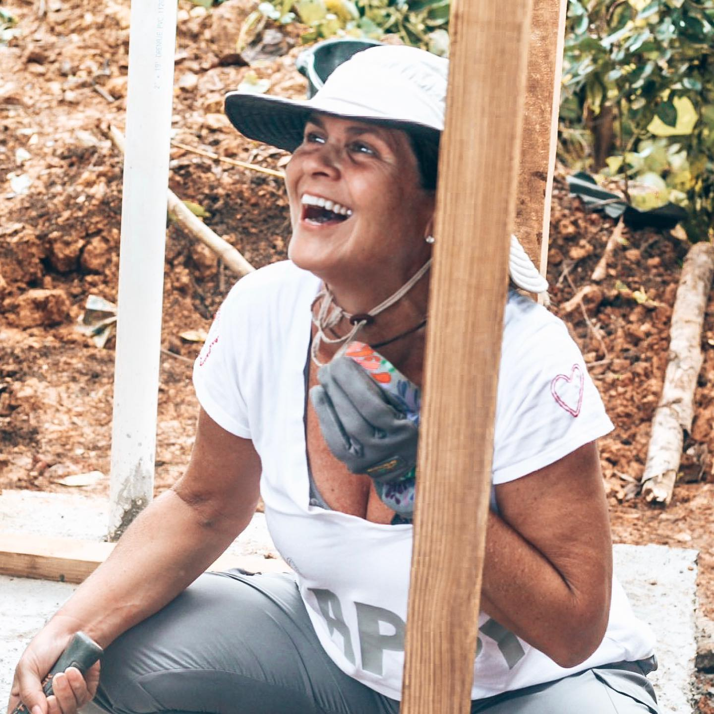 blue-missions-older-volunteer-building-a-latrine.jpg
