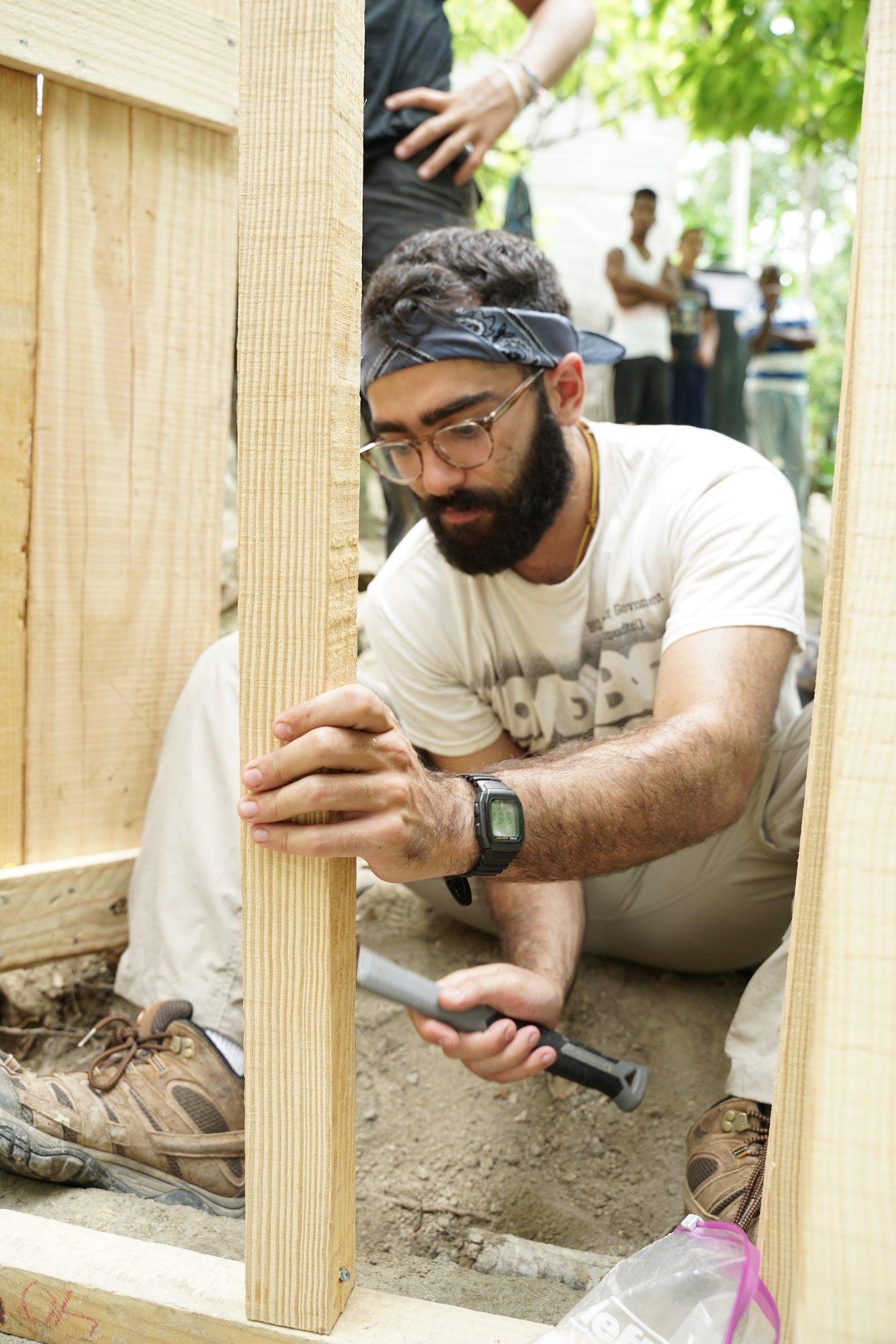 blue-missions-volunteer-finishing-a-vip-latrine.jpg