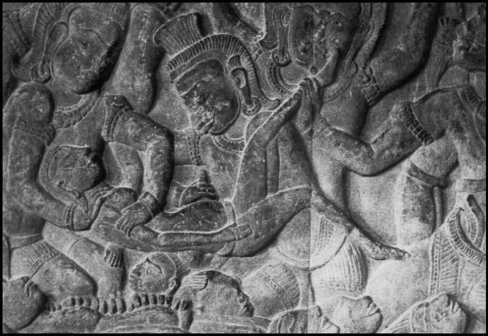 Demon performing abortion on a woman. Angkor Wat, Cambodia, c. 1150.