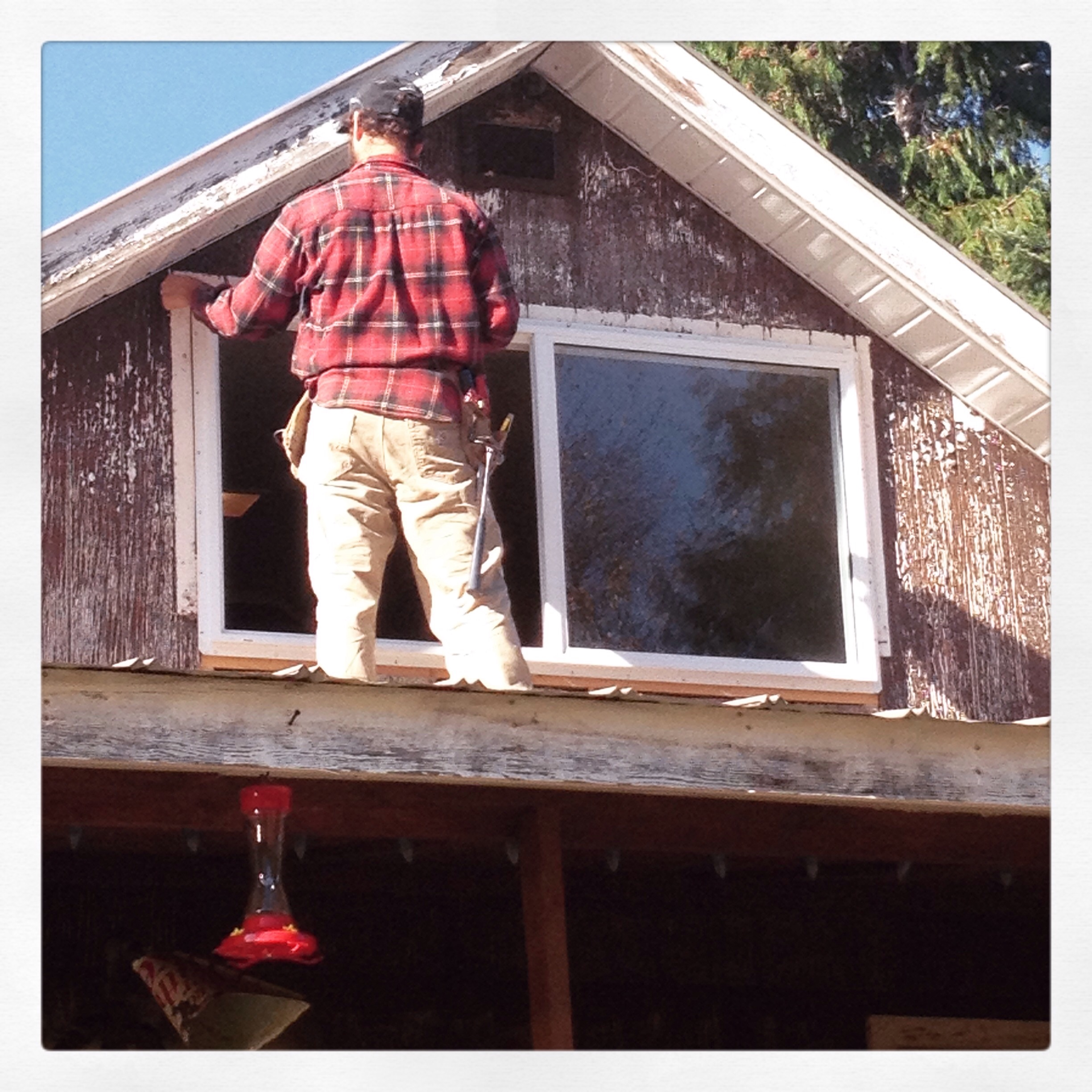 Here is Cam putting in a new window. So handy,