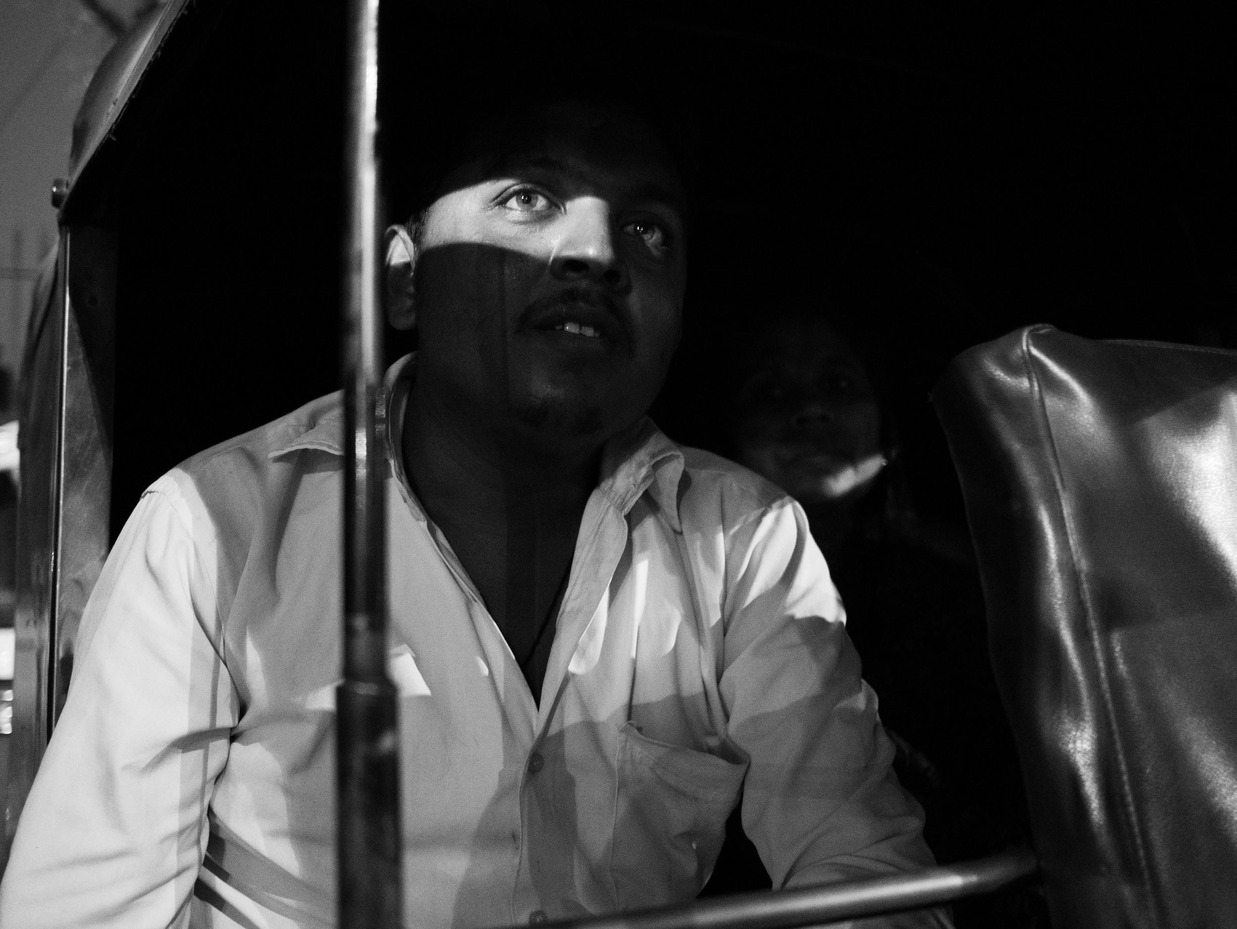 A passenger waiting in autorickshaw, part of the street photography series captured in Vadodara, Gujarat in India by Gagan Sadana.