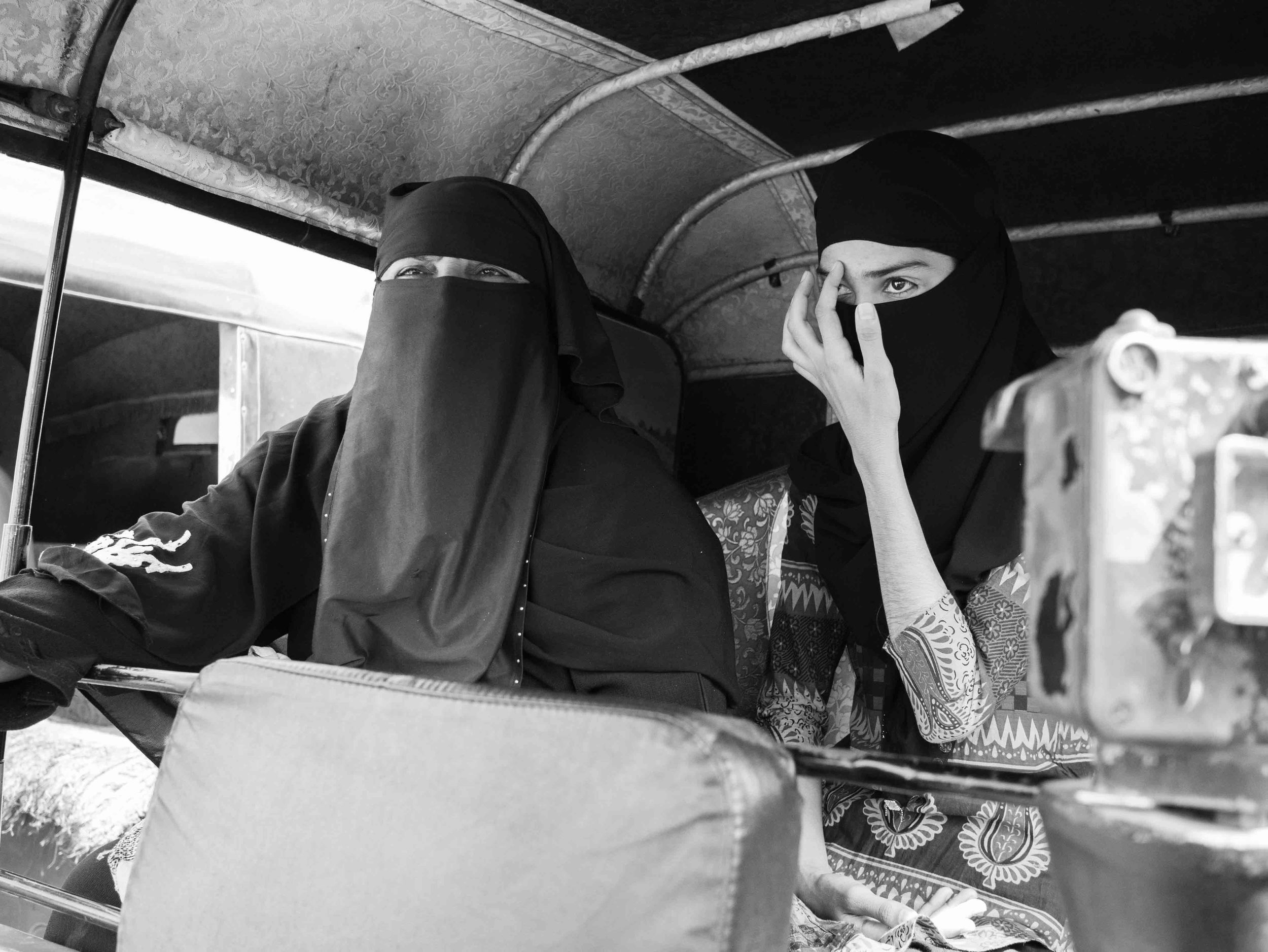 Two women passengers photographed while waiting in autorockshaw as part of the street photography series captured in Vadoadra, Gujarat, India by Gagan Sadana.