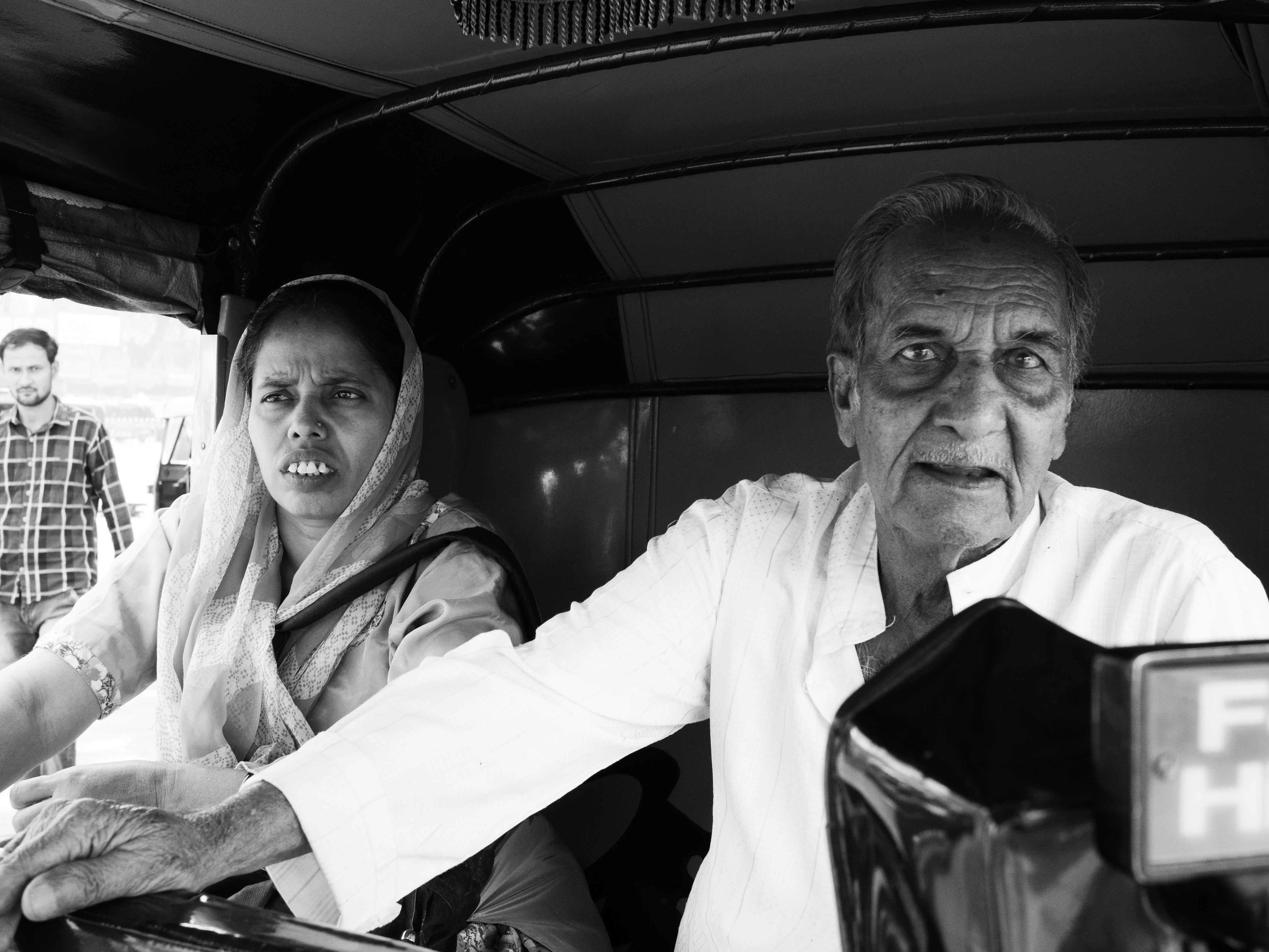 Two passengers photographed by Gagan Sadana as part of the Street Photography Series captured in Vadodara, Gujarat in India