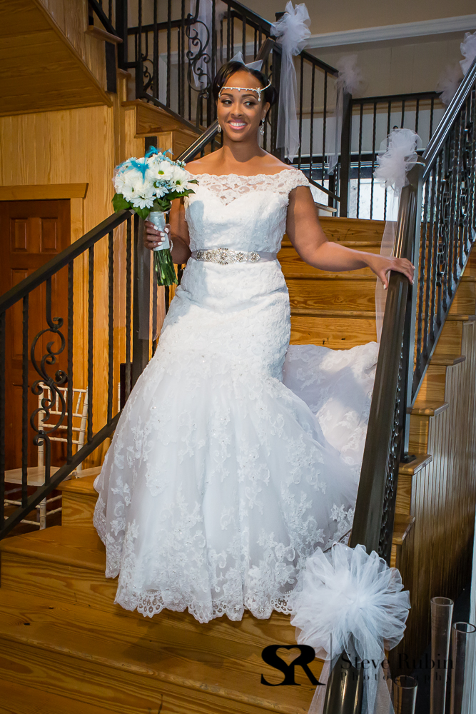 Bride coming down stairs at 105 Worth in Asherbor NC