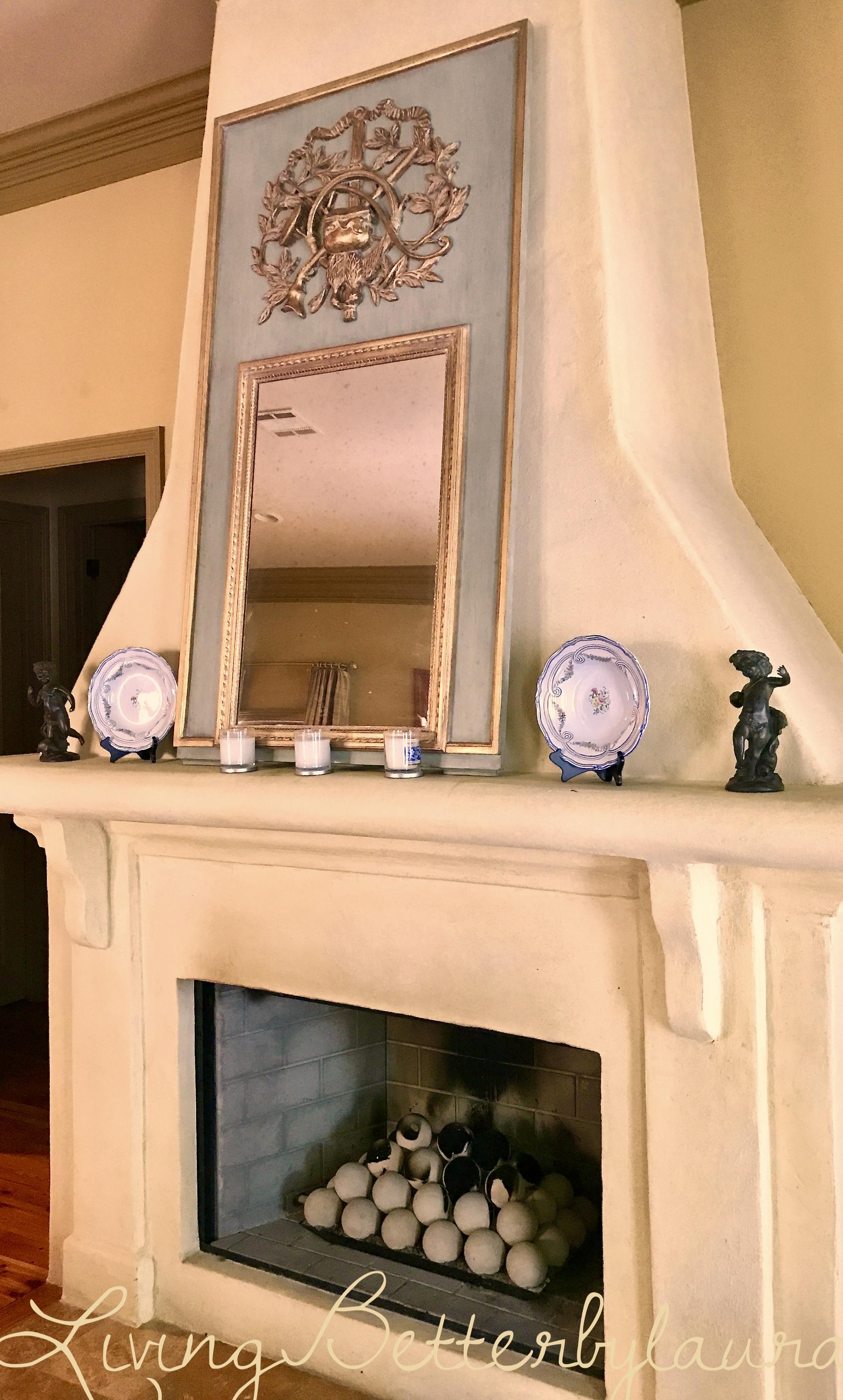 blue-interior decor-fireplace-trumeau mirror.jpeg