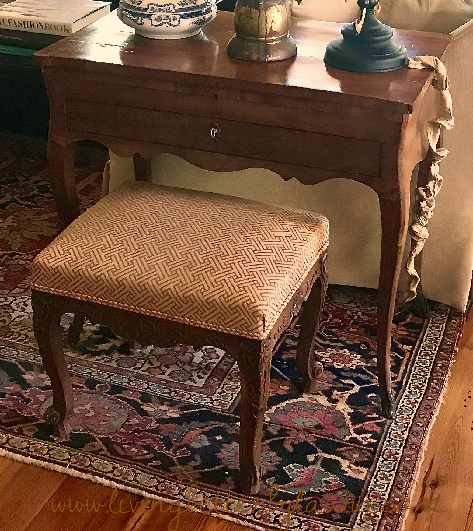 Antiques come in all shapes and sizes. Antiques shown here: Persian rug, stool recovered with new fabric, makeup vanity with mirror inside lid, and blue and white porcelain