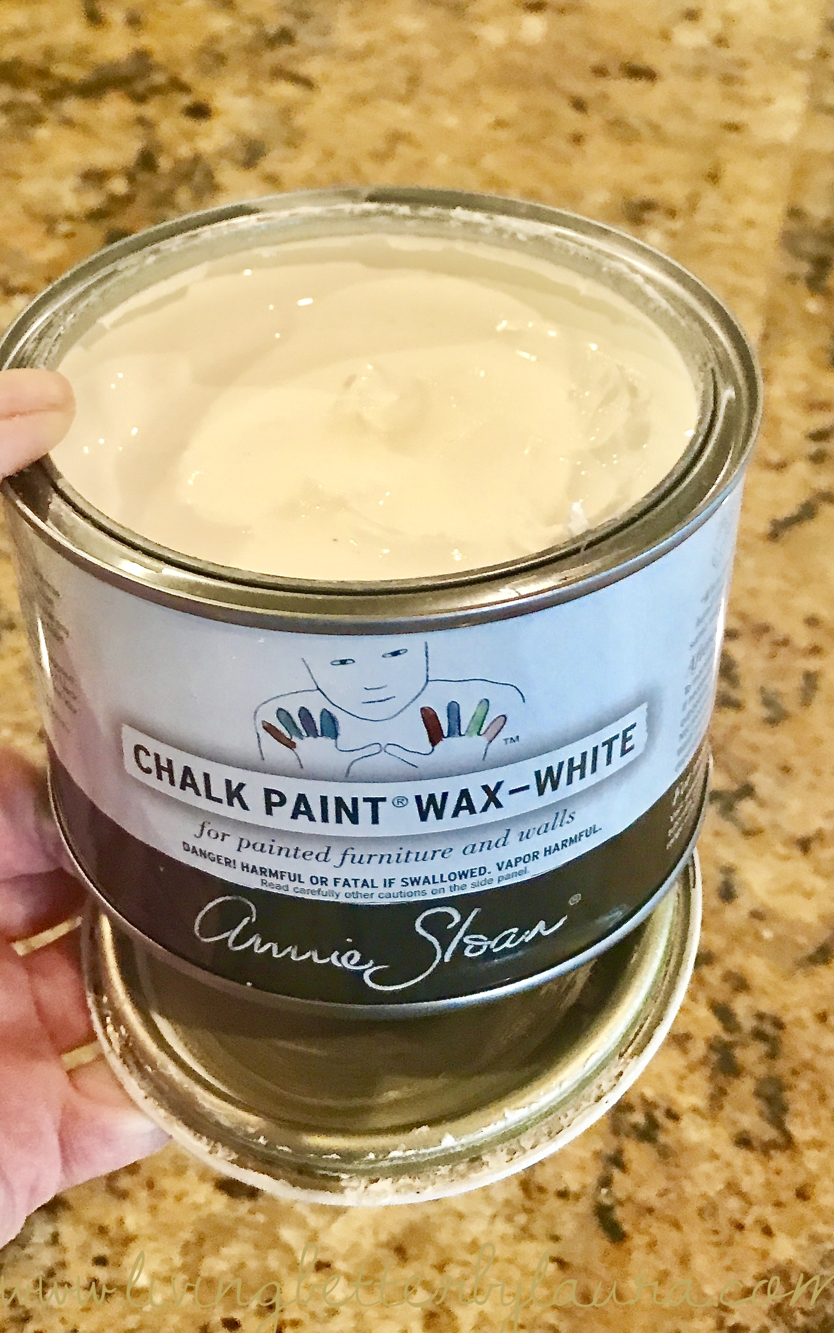 """STEP #4:  I went over the entire frame with one coat of Annie Sloan White Wax using one of Annie's wax brushes. A base coat of clear or white wax is needed before a dark was - so that the wood doesn't """"grab"""" the dark wax. It makes it easier to control the amount of dark stain.I chose Annie's white to pale out the paint colors and dull the contrast for the Base wax in this case. Most usually I use the Clear Version. After the coat of wax I immediately buffed the frame with an old, soft cotton rag, formerly a tee shirt."""