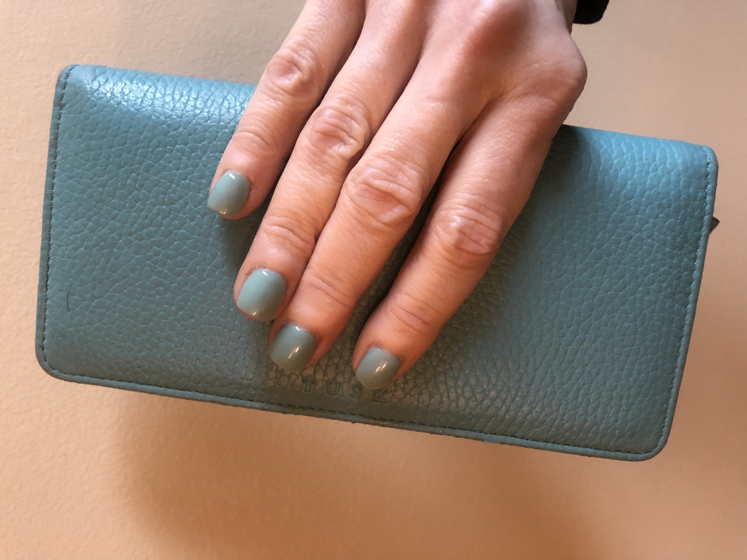 """I didn't realize my nail polish matched my wallet until later. My cuticles are much improved here. Wallet is by """"Tusk"""" - I found it at Nordstrom rack."""