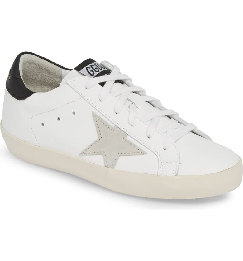 Golden Goose Superstar   For those with unlimited funds - this is the holy grail of sneakerdome. For those of us, unable or unwilling to splurge $495 for tennis shoes, you can use this image to choose a more budget conscious style. Shown here in beige, white and black. This is the perfect color combo in my book.