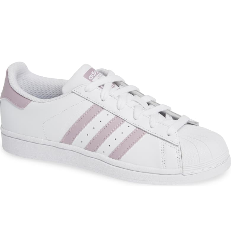 Adidas Superstar   A classic returns. I saw tons of this brand in Italy this Spring. This style is $80. It comes in several options. I love the black stripe accent and this blush. There's a solid white choice as well. I'm torn between the black stripe to coordinate with my mostly black legging wardrobe or the trendy pink shade. But solid white is THE strong piece for now.