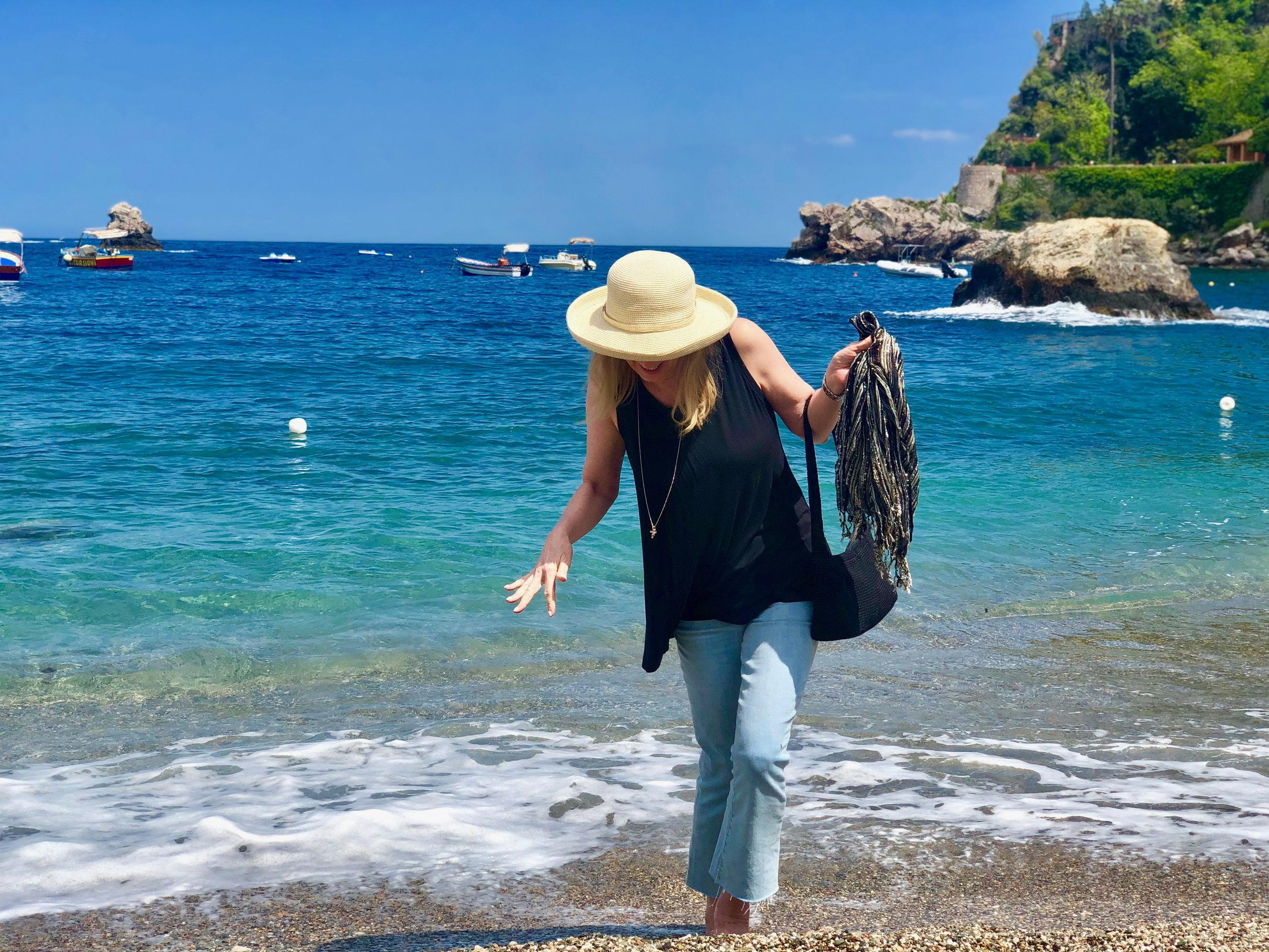 My pair of Paige cropped flare high waist jeans are comfortable, trendy AND appropriate for any age. Here, seen getting the hems wet in the Mediterranean Sea in Taormina, Sicily, Italy this May. The little bit of stretch makes for ingesting lots of wine, pasta, pizza and still travel comfortably.