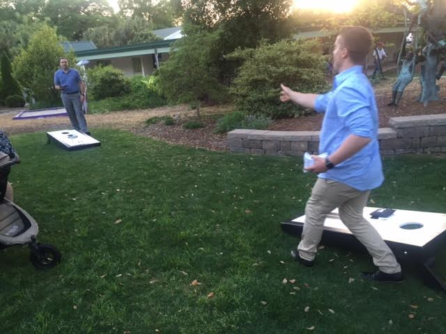 Brian & Josh (hubby of photgrapher Wynona Benson) trying out the new corn hole set at the Bridal Mixer