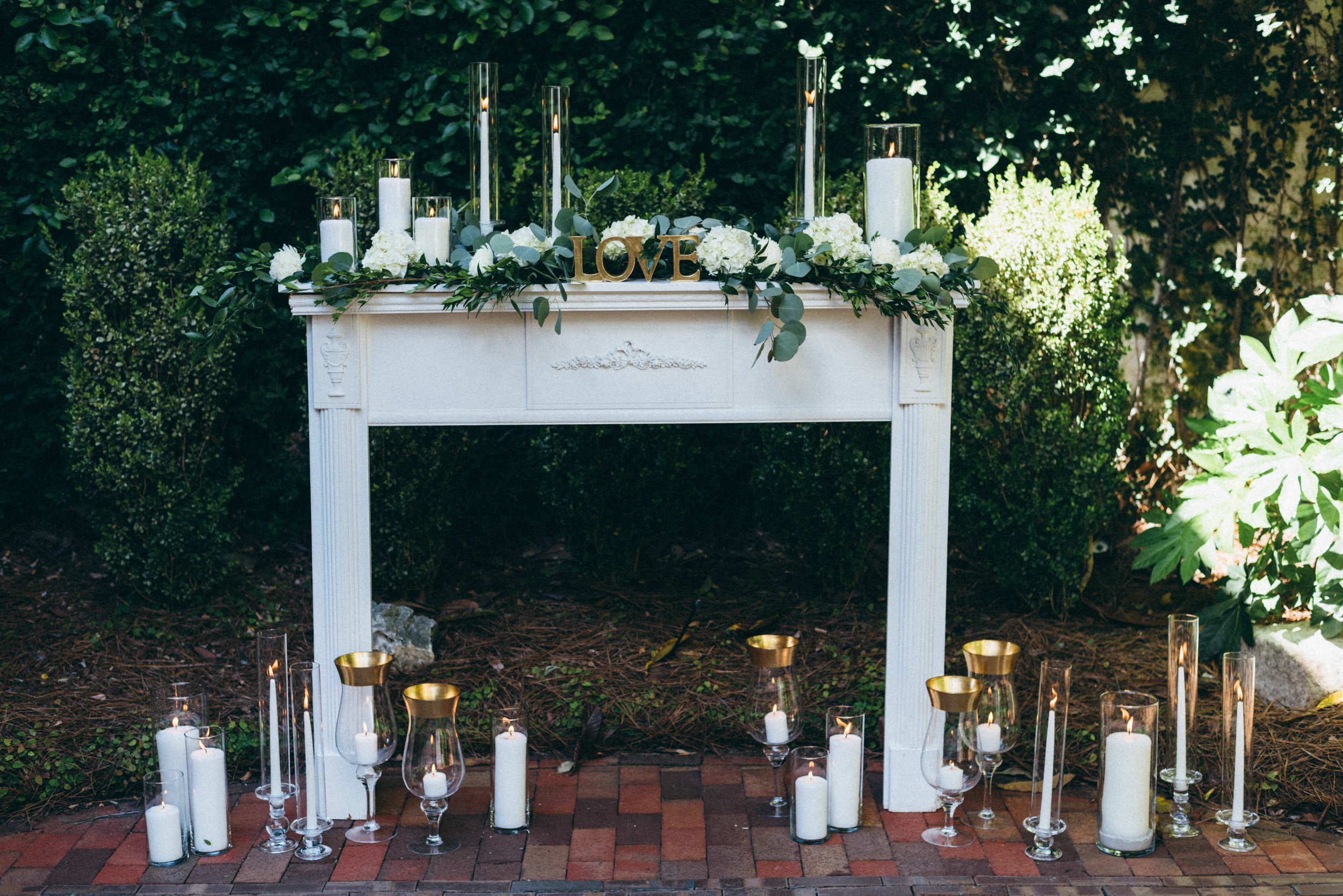 Our Vintage Mantle with floral and candles added by  Design Perfection