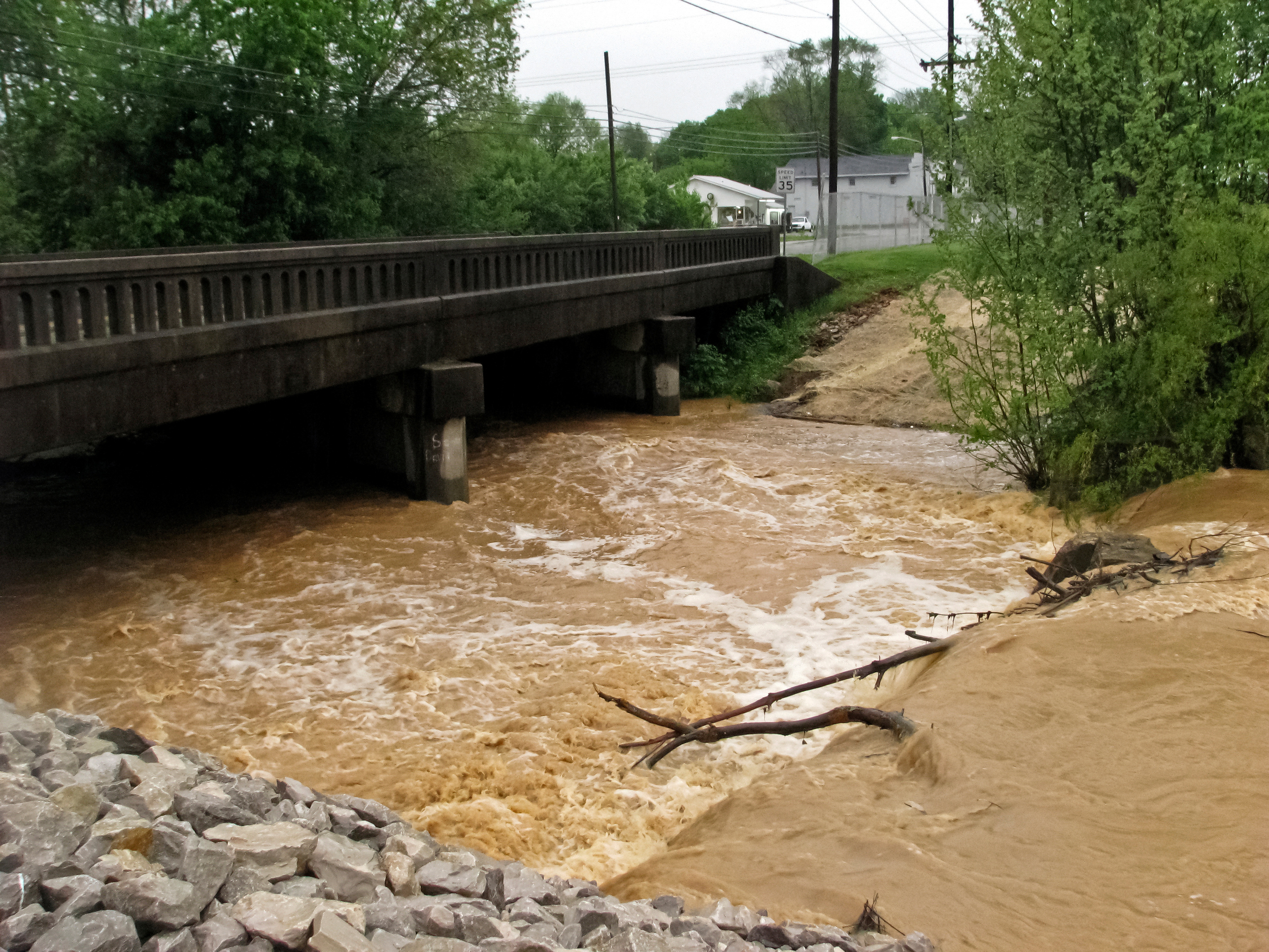 Gorin Park's creek rapidly flows under the bridge on East Main Street in Glasgow.