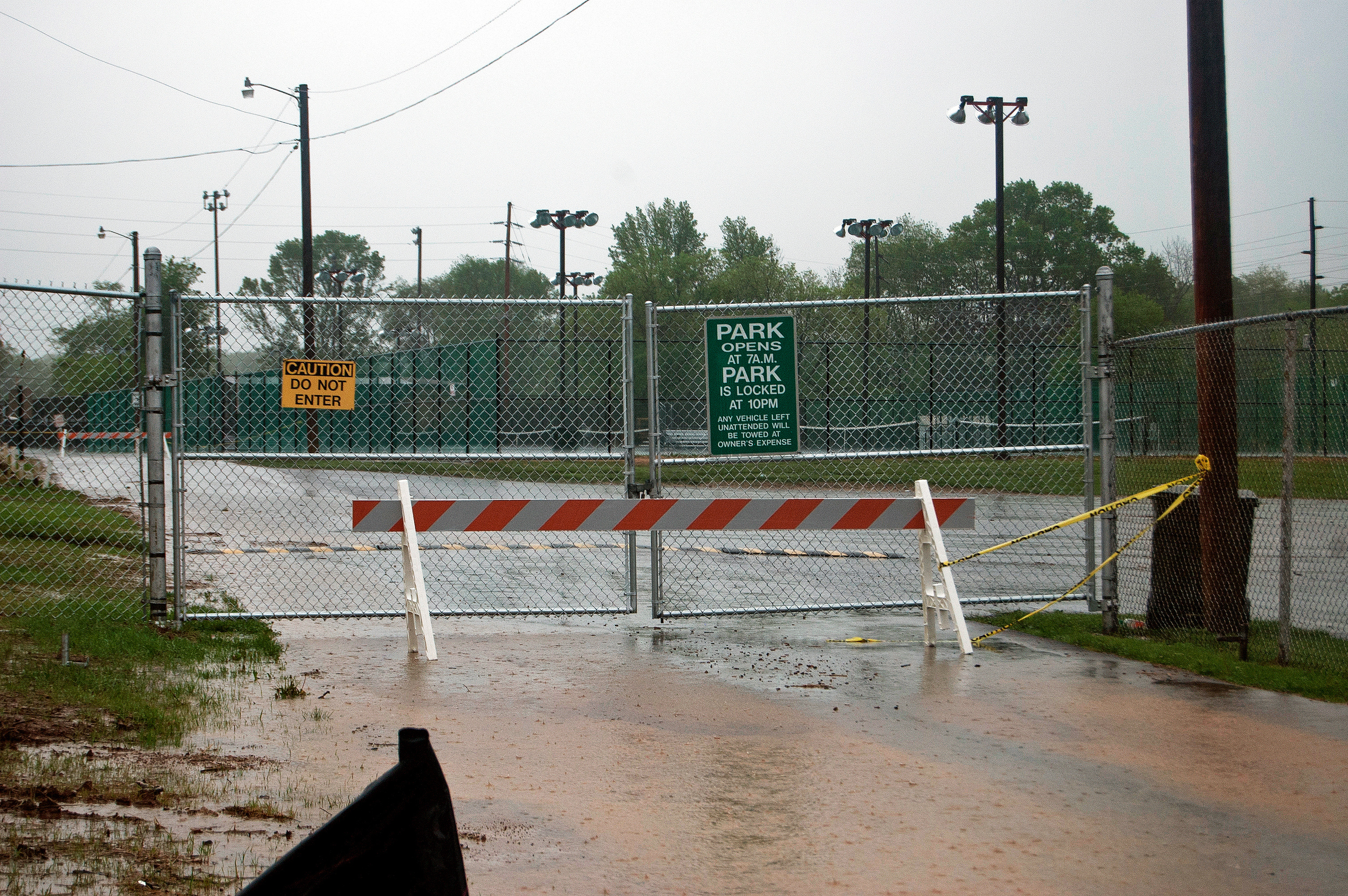 Gates locked at Gorin Park to protect public from flooding dangers.