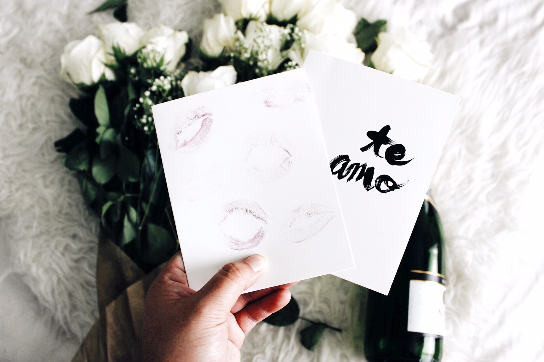 put some lipstick on and smooch it on a blank card or use acrylic paint to write your favorite quotes.
