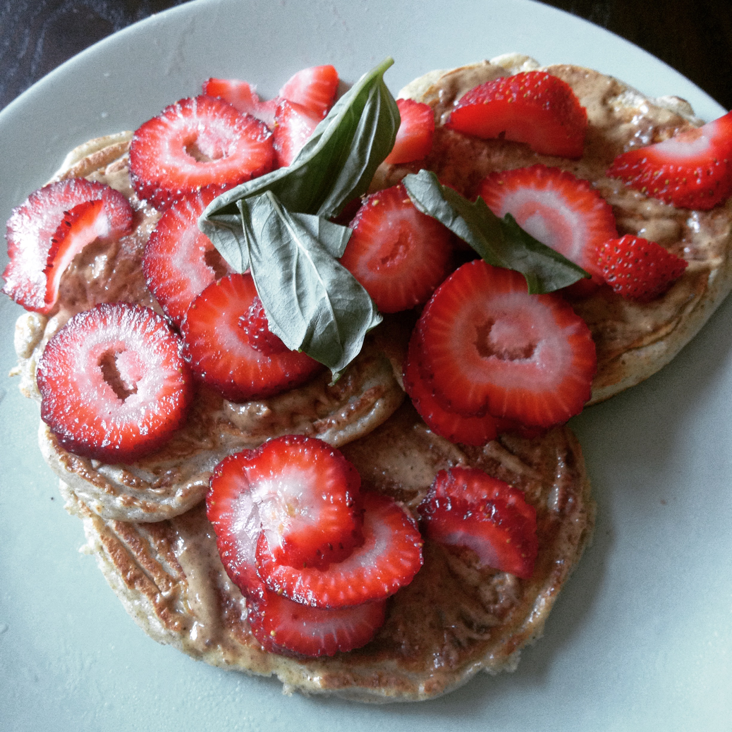 Protein Blender Pancakes with Almond Butter, Basil & Strawberries.  Because life ain't worth living unless there are pancakes