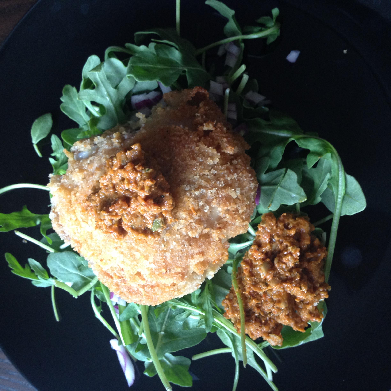 Crispy Chicken Thighs with Arugula & Pumpkin Seed  Sundried Tomato Pesto. Yumsters