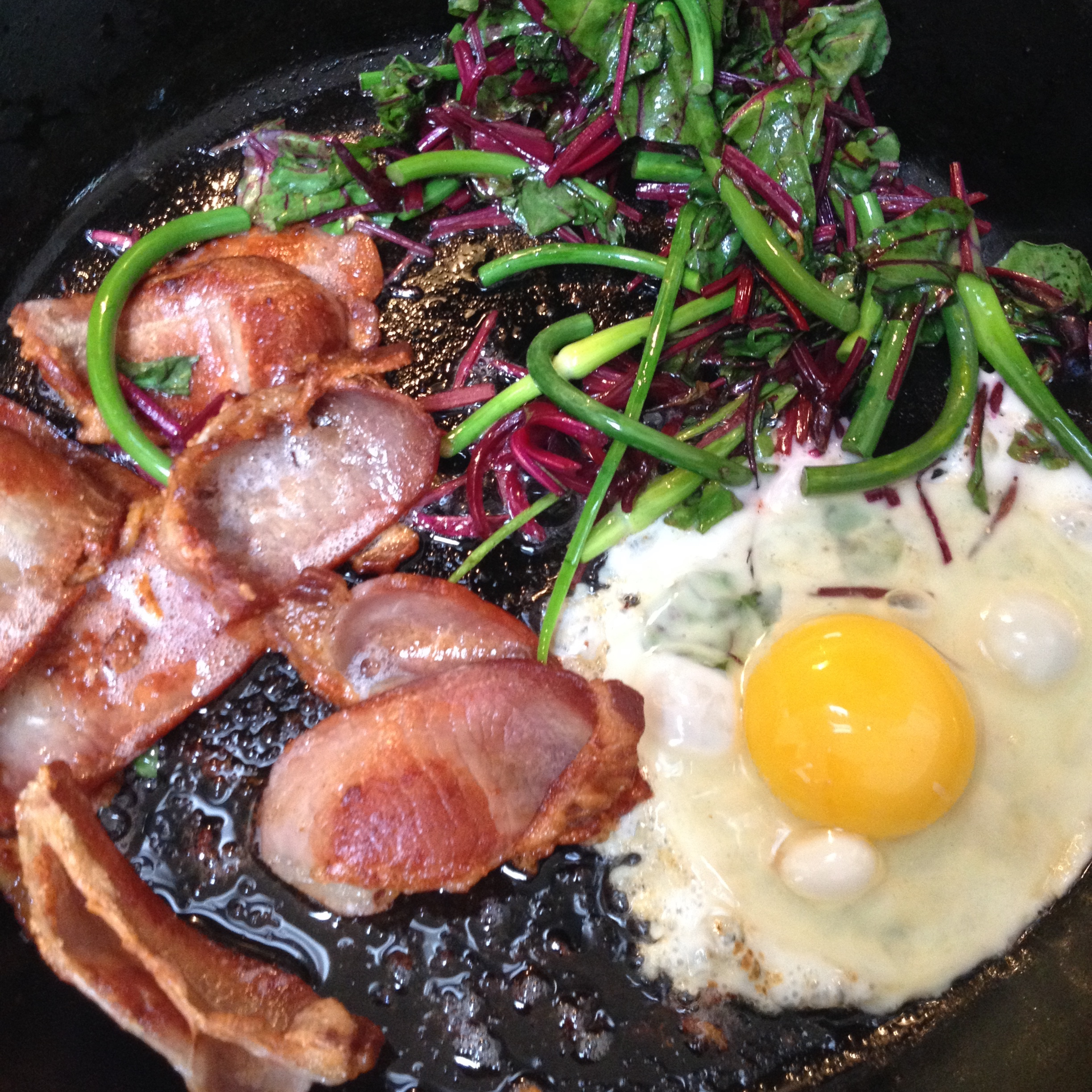 I treated myself with bacon, eggs, beet greens, and garlic scapes