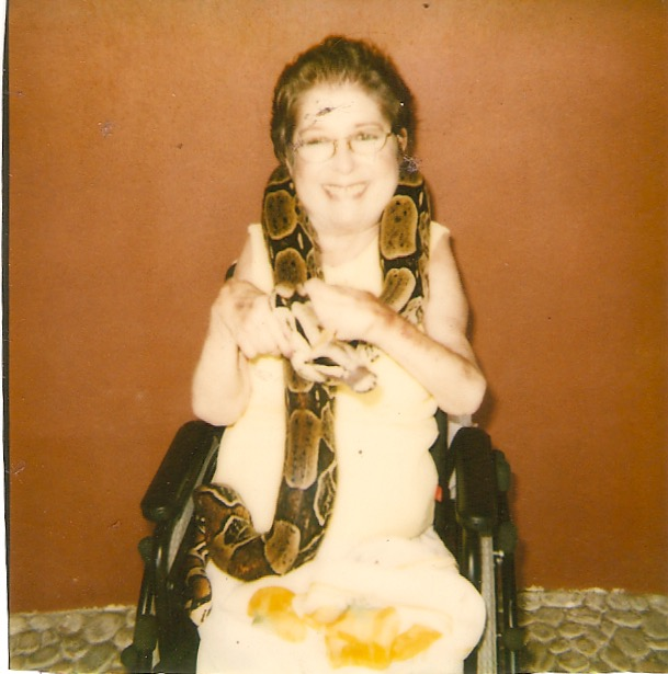 And yes, that's my mom, in her wheelchair.. holding a live boa.