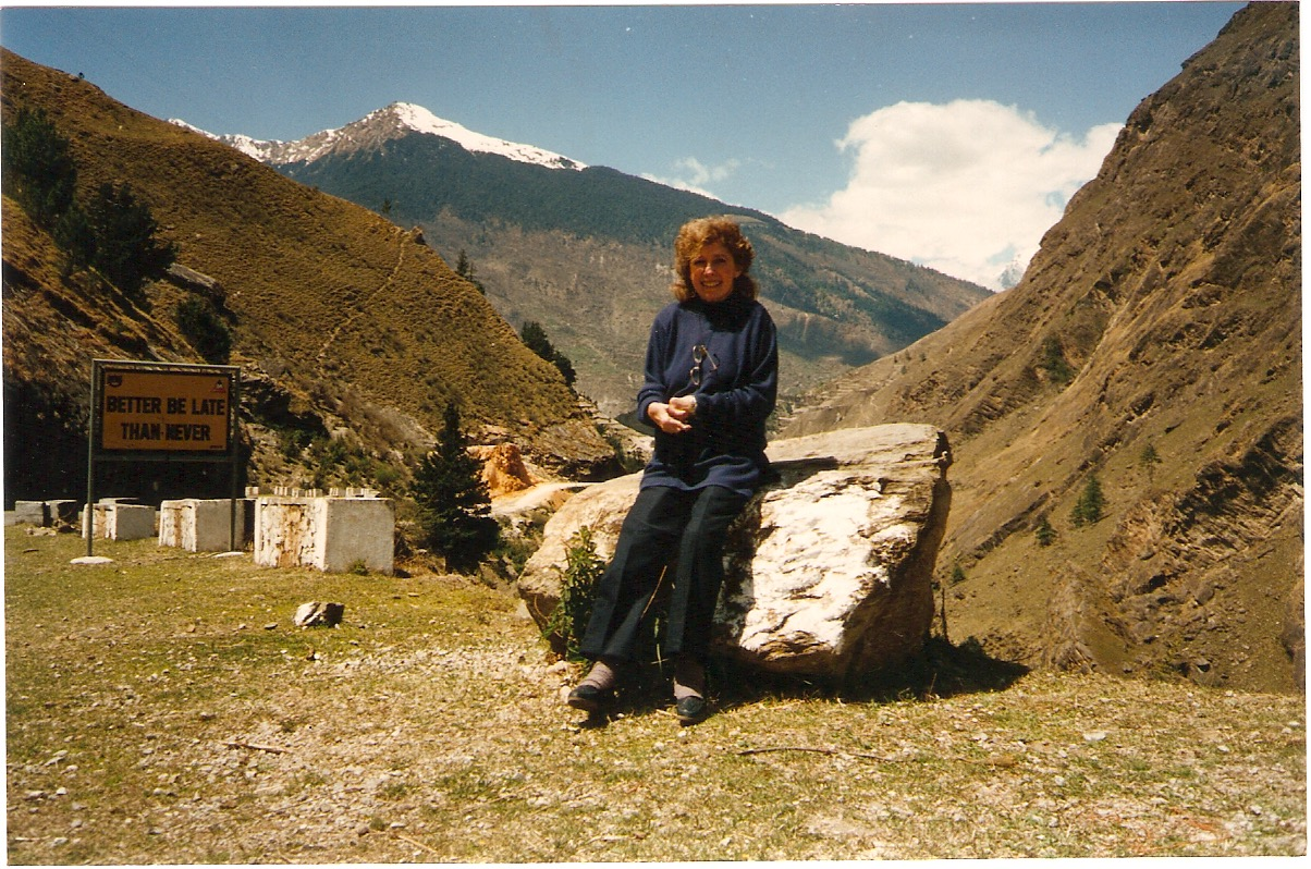 "Mom in The Himalayas... the sign reads: ""Better be Late, than Never""."
