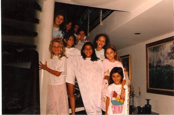 I told you I'd try to find an old photo of that party. Oh boy!...There I am, with the Belle nightgown second on the right from bottom to top.