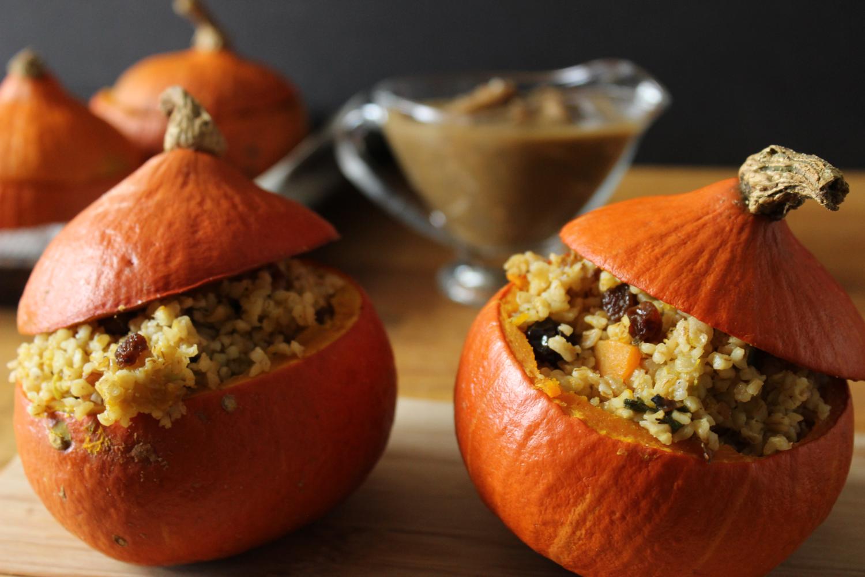 vegan_holiday_recipes_vegan_stuffed-pumpkins_with_a_sage_bulgur_fall_filling_and_a_creamy_mushroom_gravy.png