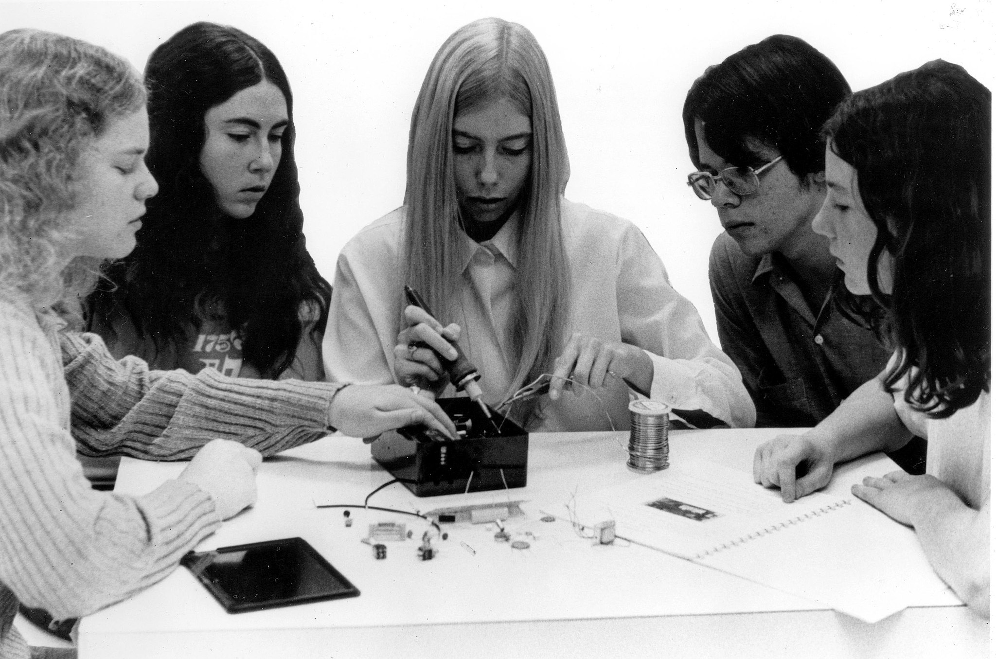 A group of high school students constructs basic measuring devices for testing air, water, noise, and radiation-pollution levels. c. 1972