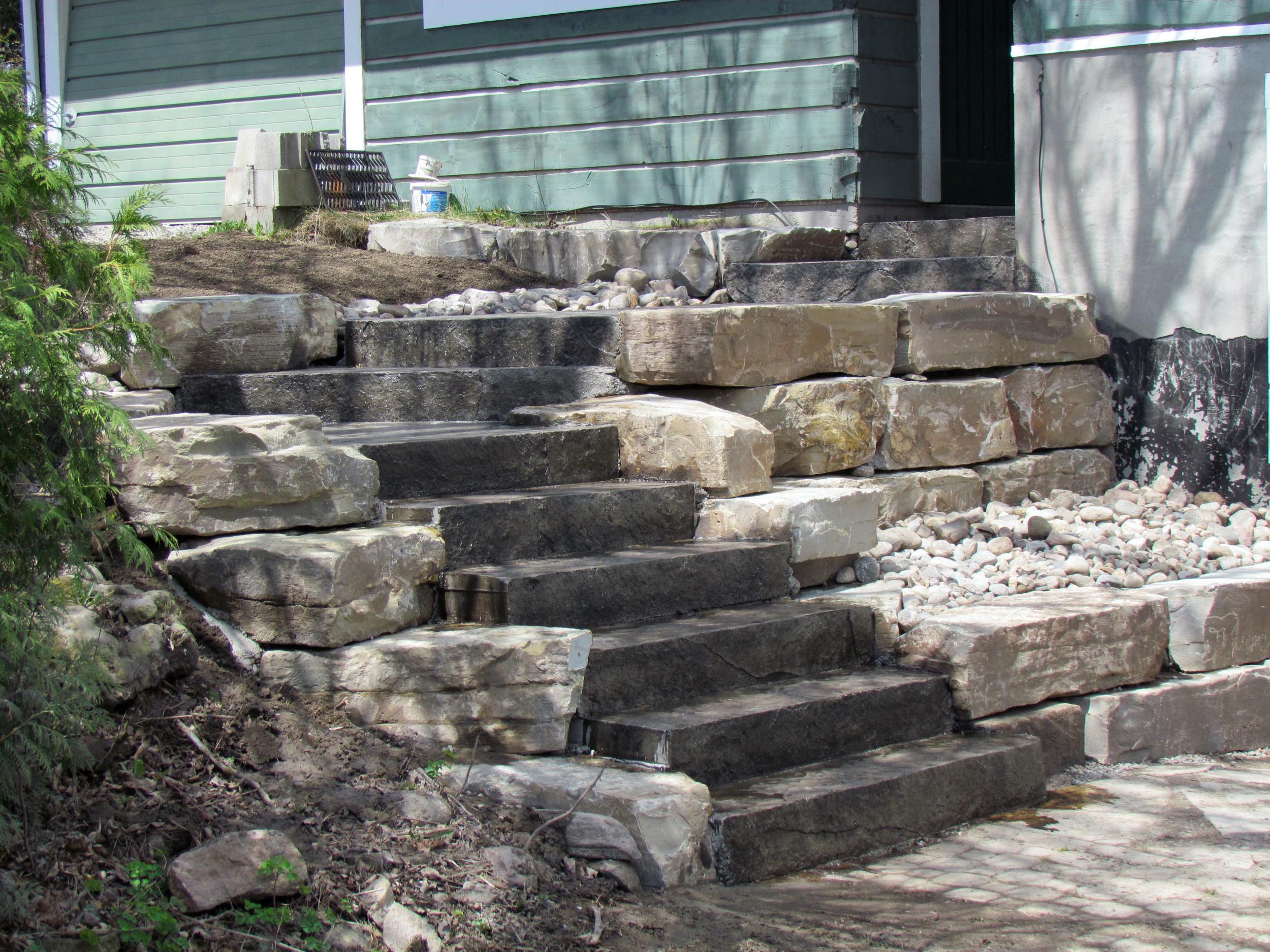 Limestone retaining wall with Seamless Roughstone stairs.jpg
