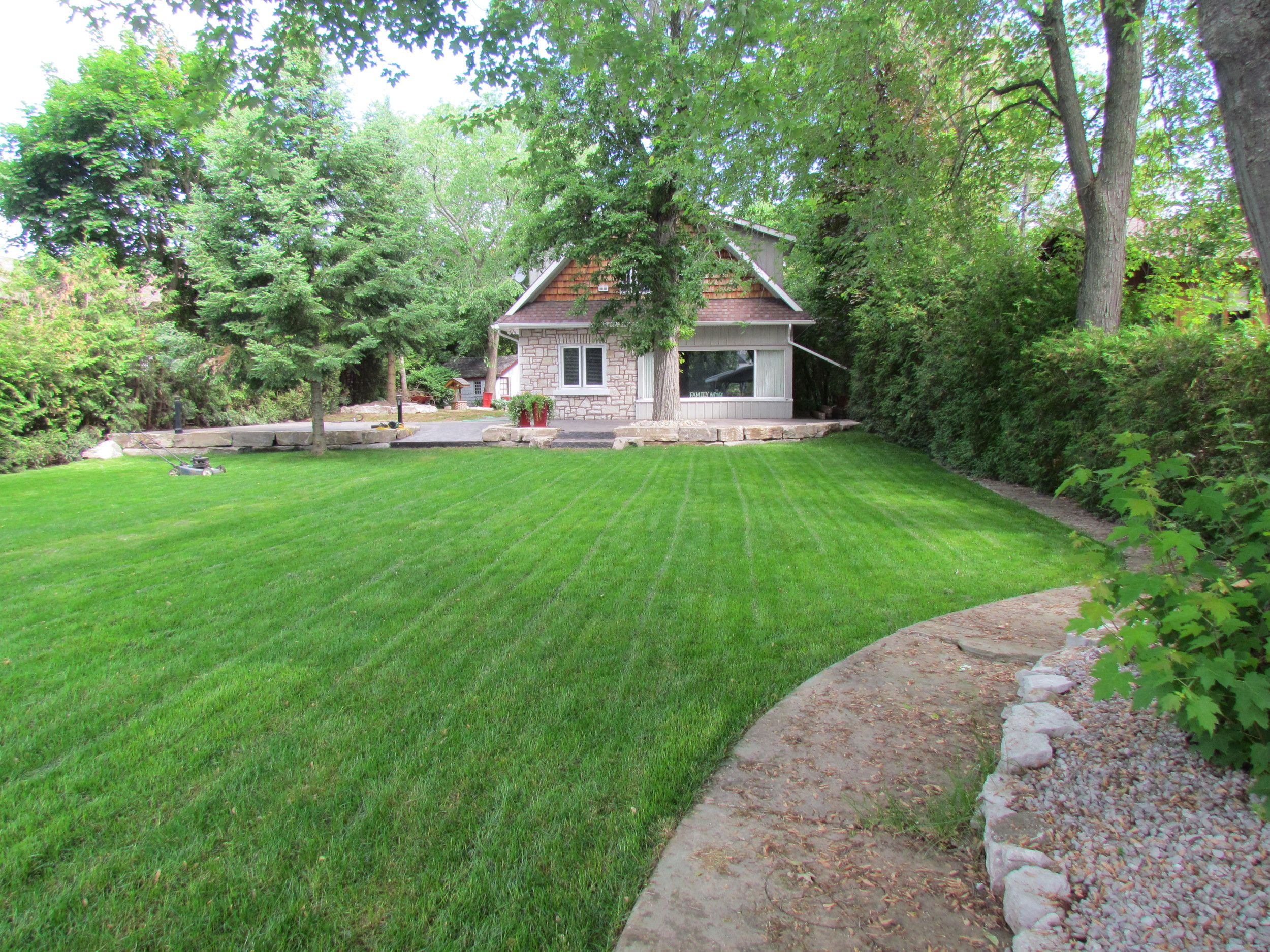 New sod and Limestone walls with large stamped patio areas.JPG