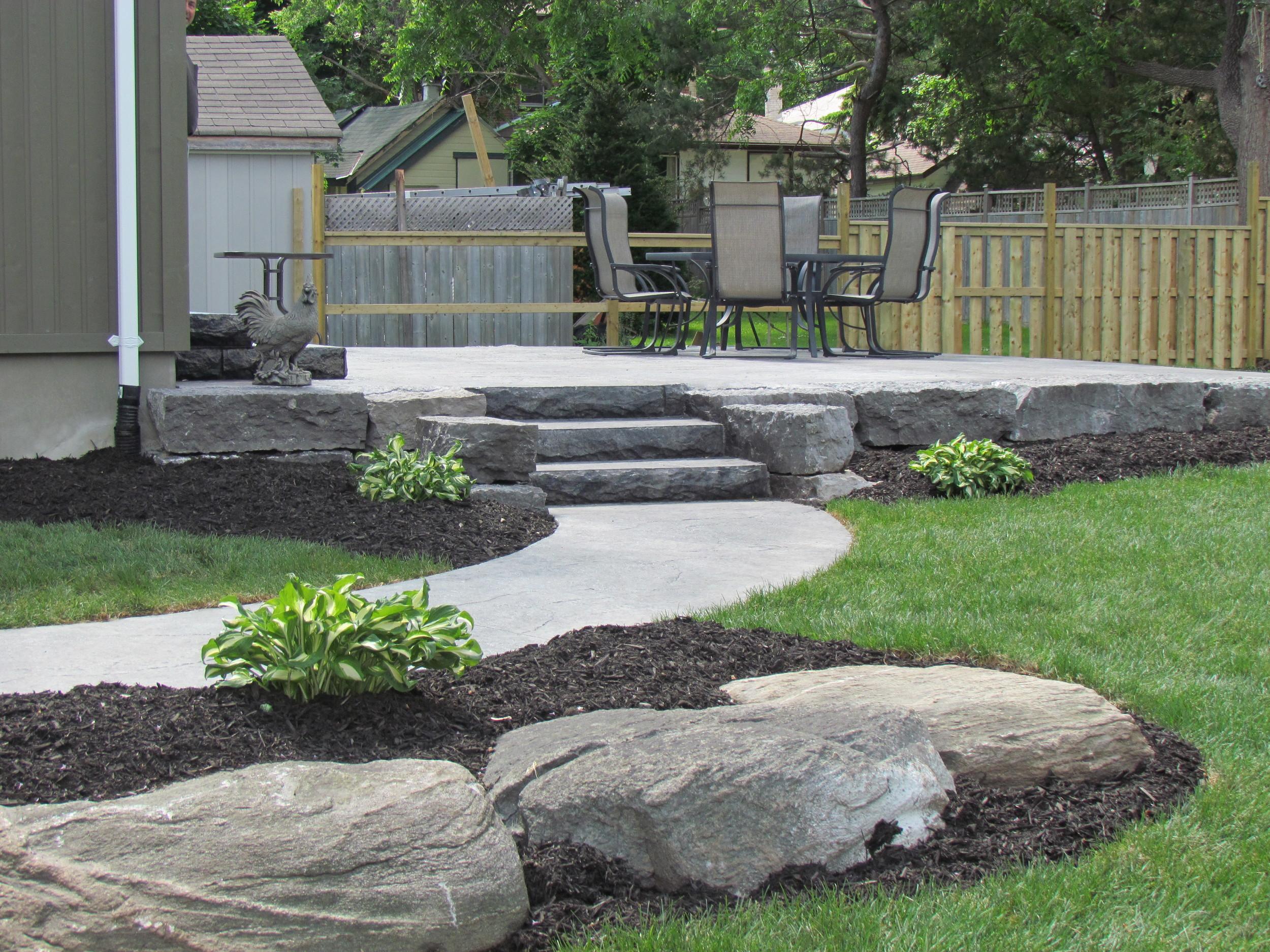 Raised patio in natural grey limestone colouring.JPG