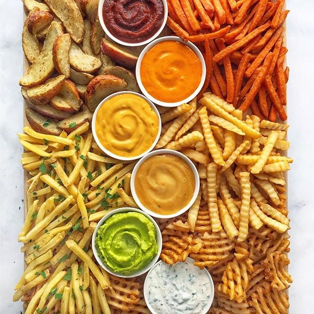 This French Fry platter from @thedelicious is an incredible party-on-a-plate concept... Whether you're headed to a party or planning to host one, these spuds are sure to inspire.✨🍟 Whatever your preference for fries, be they crispy sweet potato, steak fries, waffle fries, matchstick fries or a classic Crinkle-cut french fry, guests might like to try them all with colorful, plant-strong  dips, sauces & condiments. True #comfortfood ❤️🧡💚💙💛💜 #plantbased #frenchfries  #wellnesswednesday