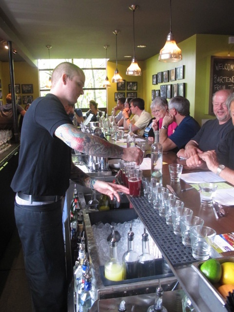 behind the bar with customers.jpg