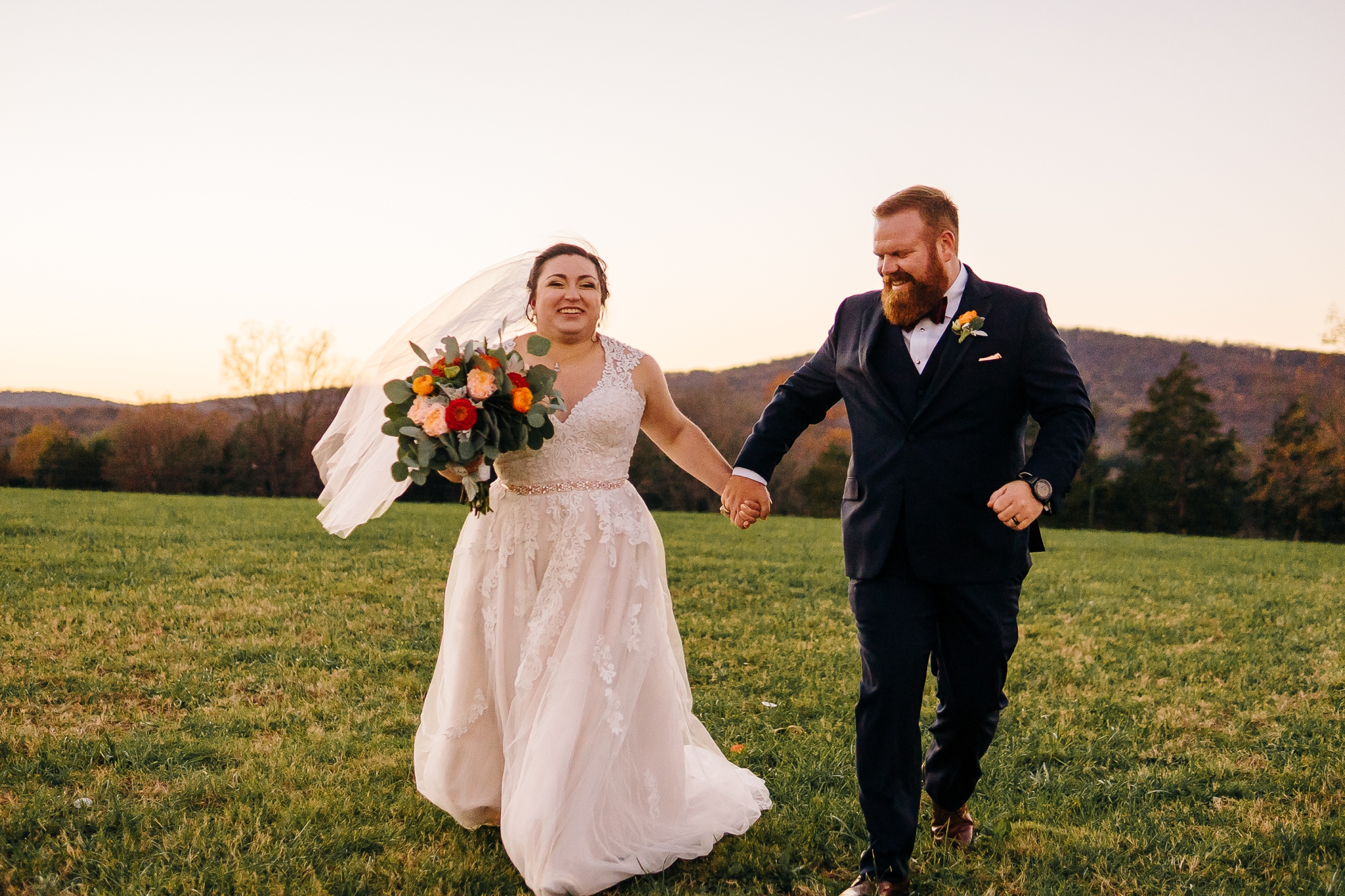 Bride_and_groom_portraits_running_in_field_at_wolftrap_farms_by_jonathan_and_hannah_photography