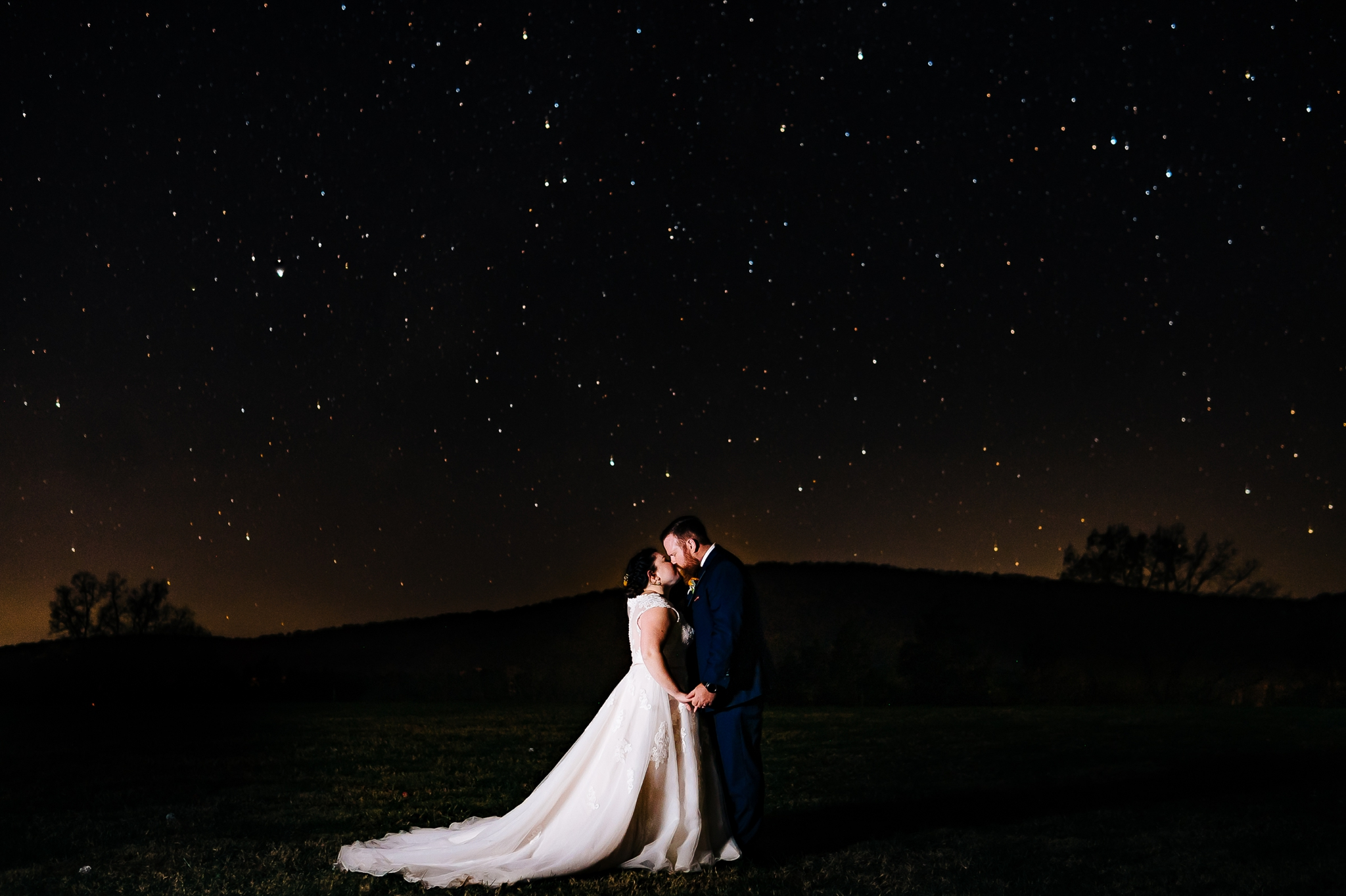 Bride_and_groom_night_portrait_standing_in_field_at_wolftrap_farms_by_jonathan_and_hannah_photography