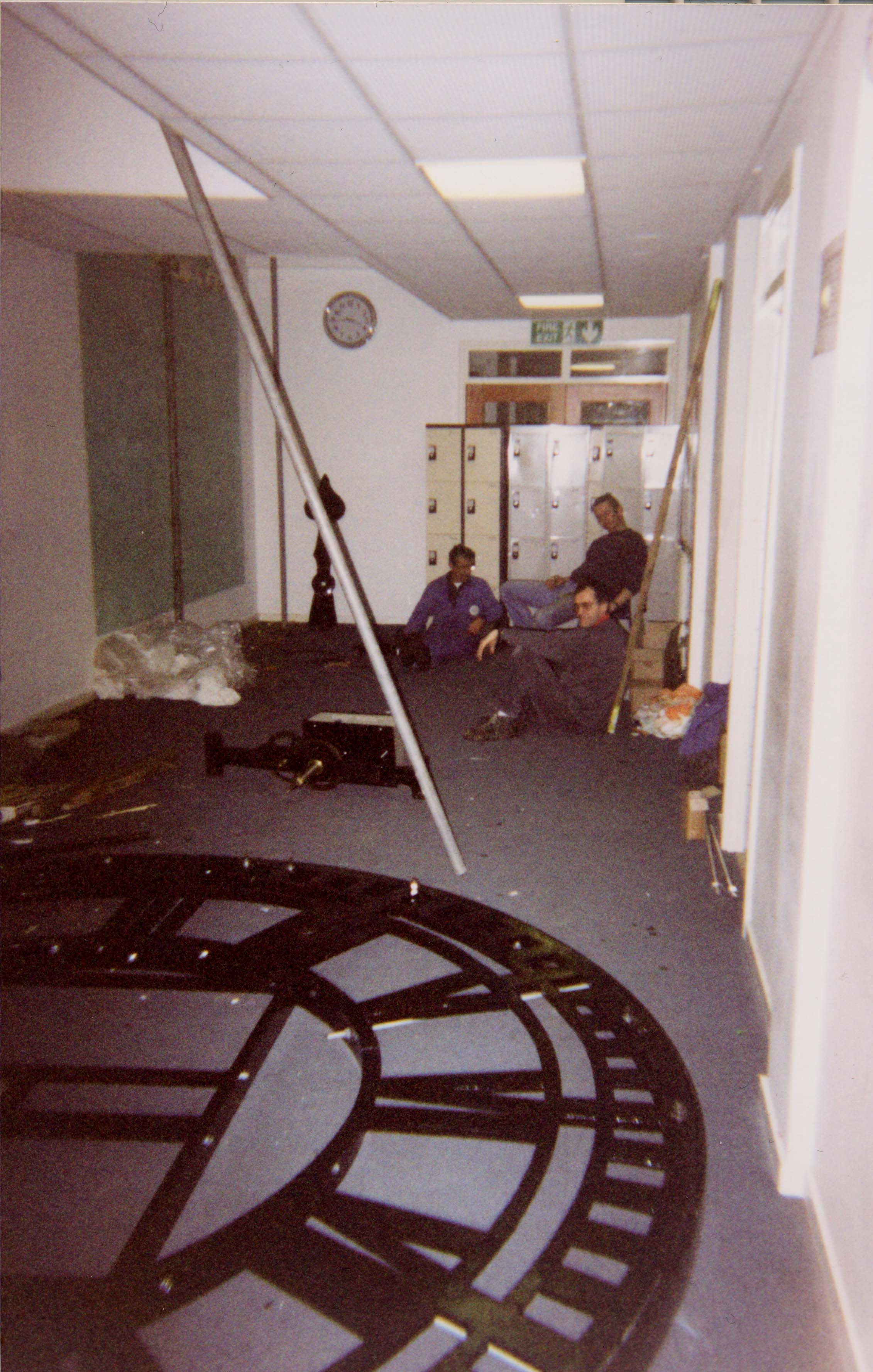 Workers resting the Clockface in Westwood High School for Girls 2002 Gudrun Nielsen.jpg