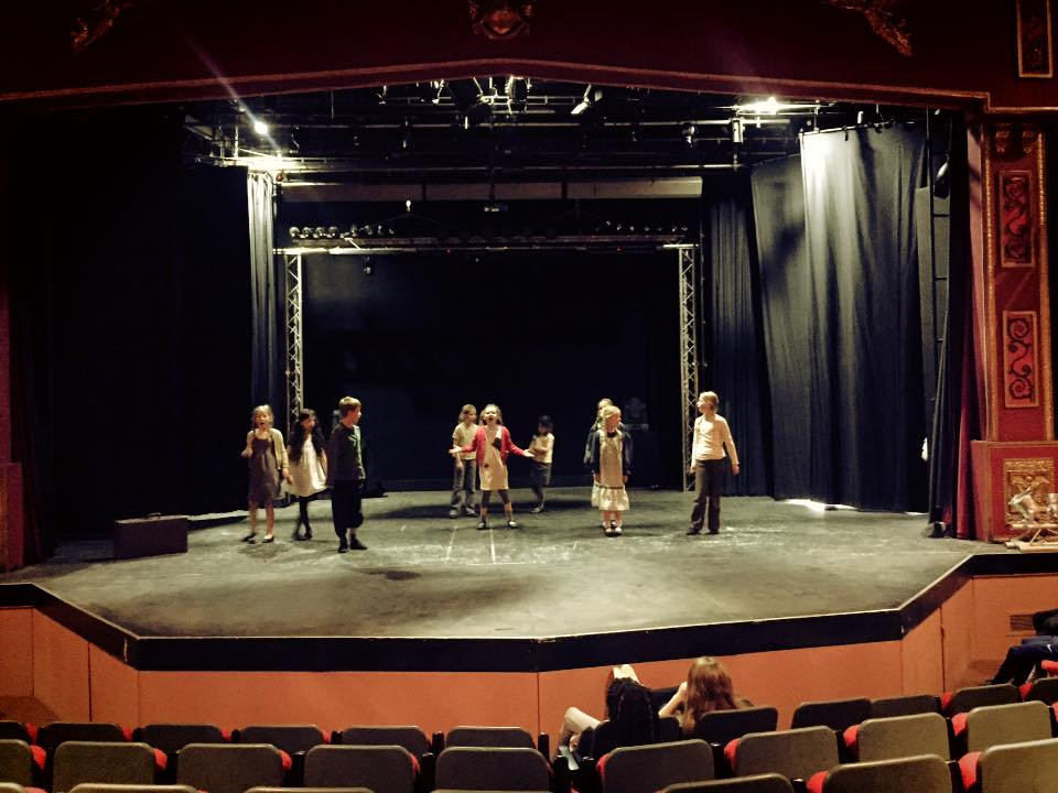 Students performing at the Thwaites Empire Theatre, Blackburn