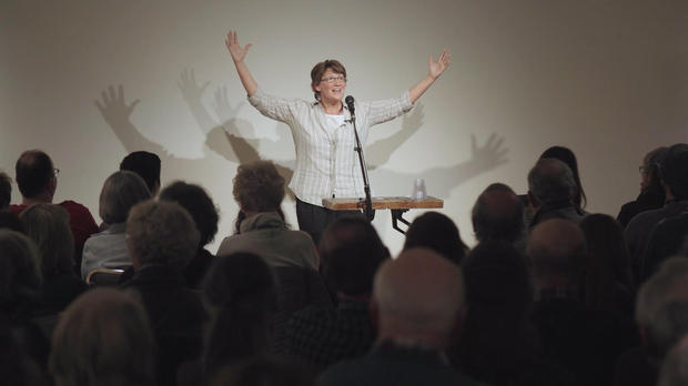 Susanne Schmidt on stage at a storytelling show. CBS NEWS