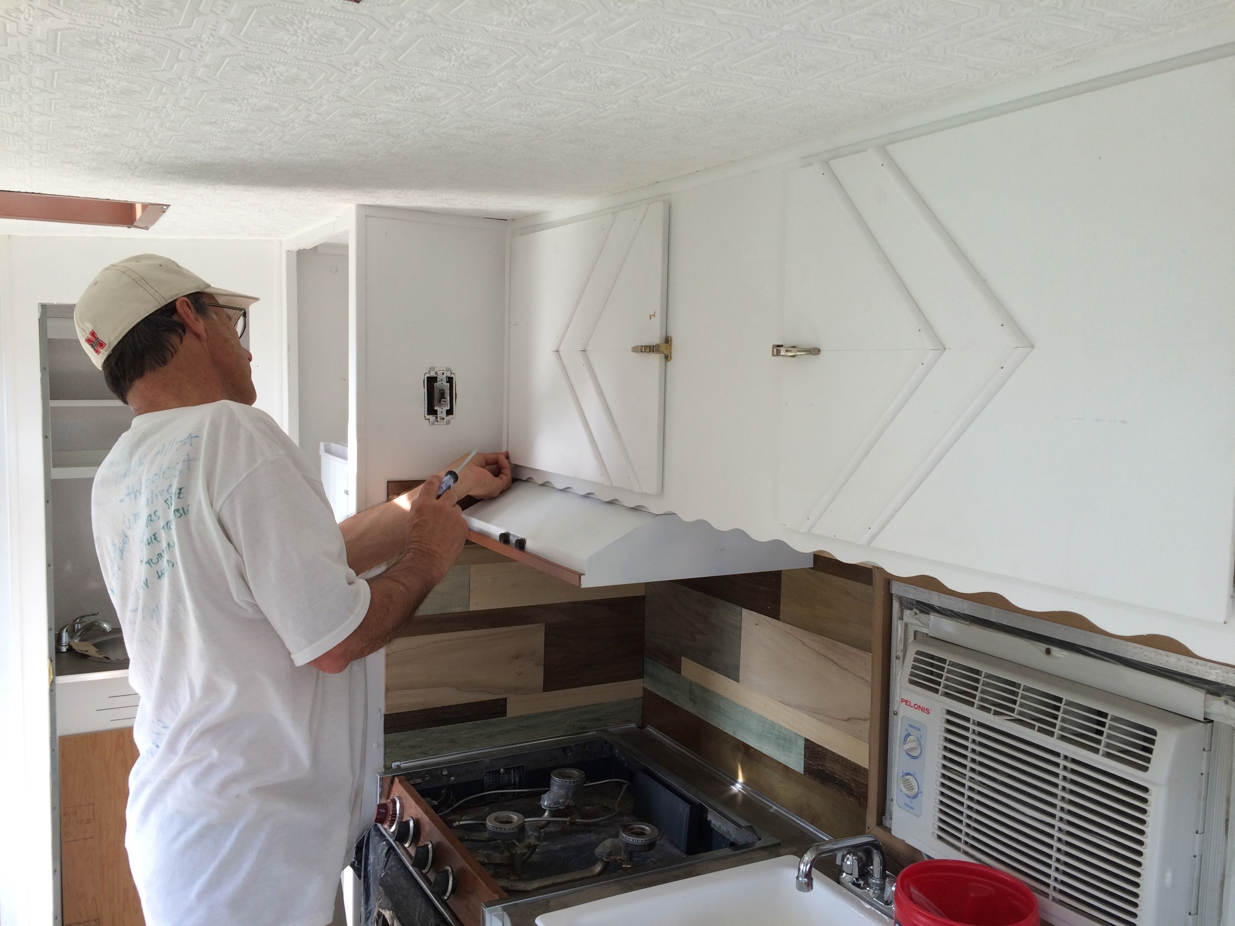 Jerry, Carson's dad, helping us install the first of our newly designed cabinets!
