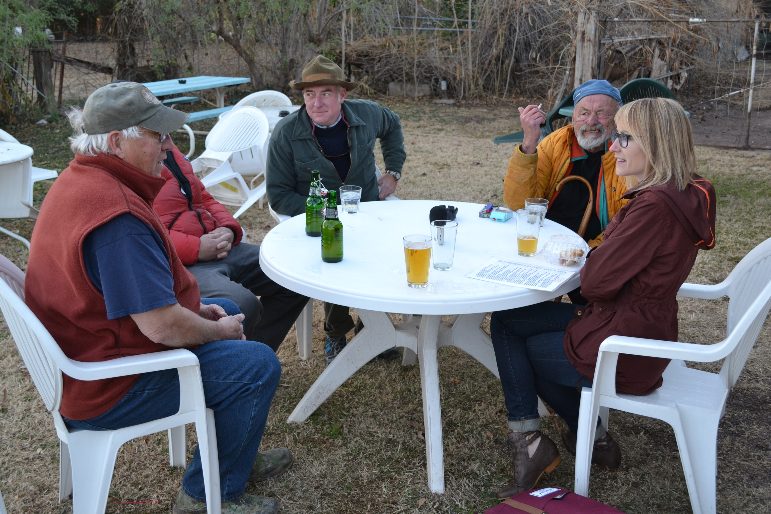 Mel holds her own at a table with novelist/poet Jim Harrison (second from the right)and a group of hunters at the Wagon Wheel Saloon in Patagonia, AZ.