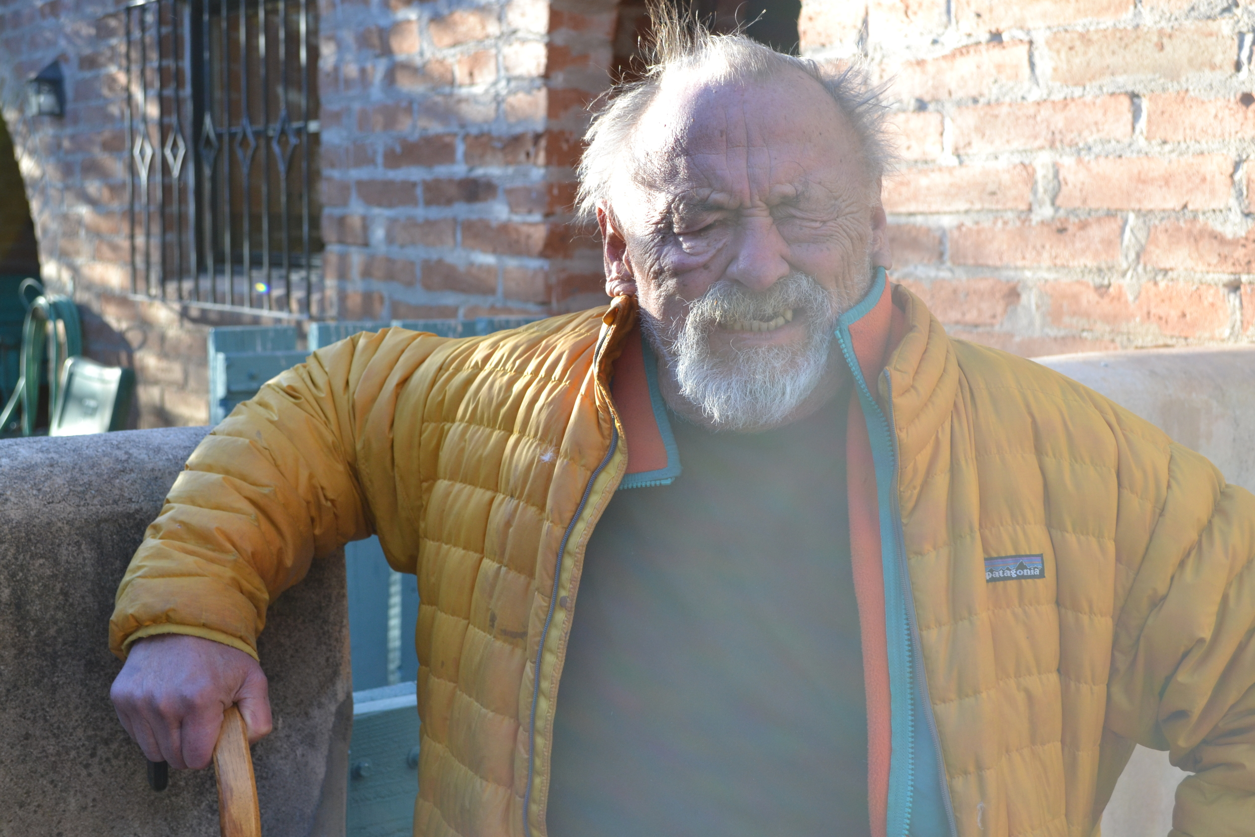 Jim Harrison poses for the camera outside his Patagonia ranch house.