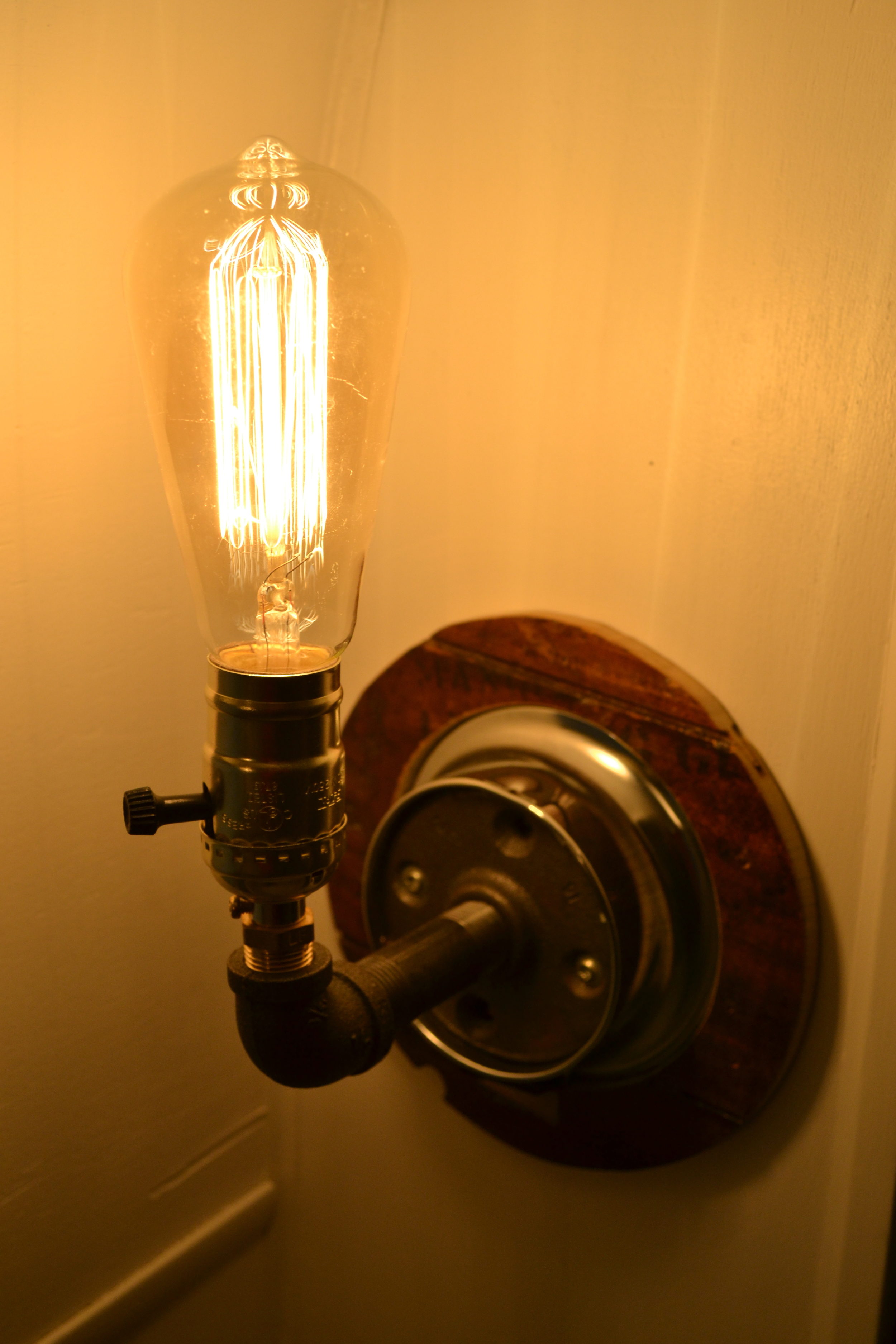 Edison bulb in our finished pipe light.